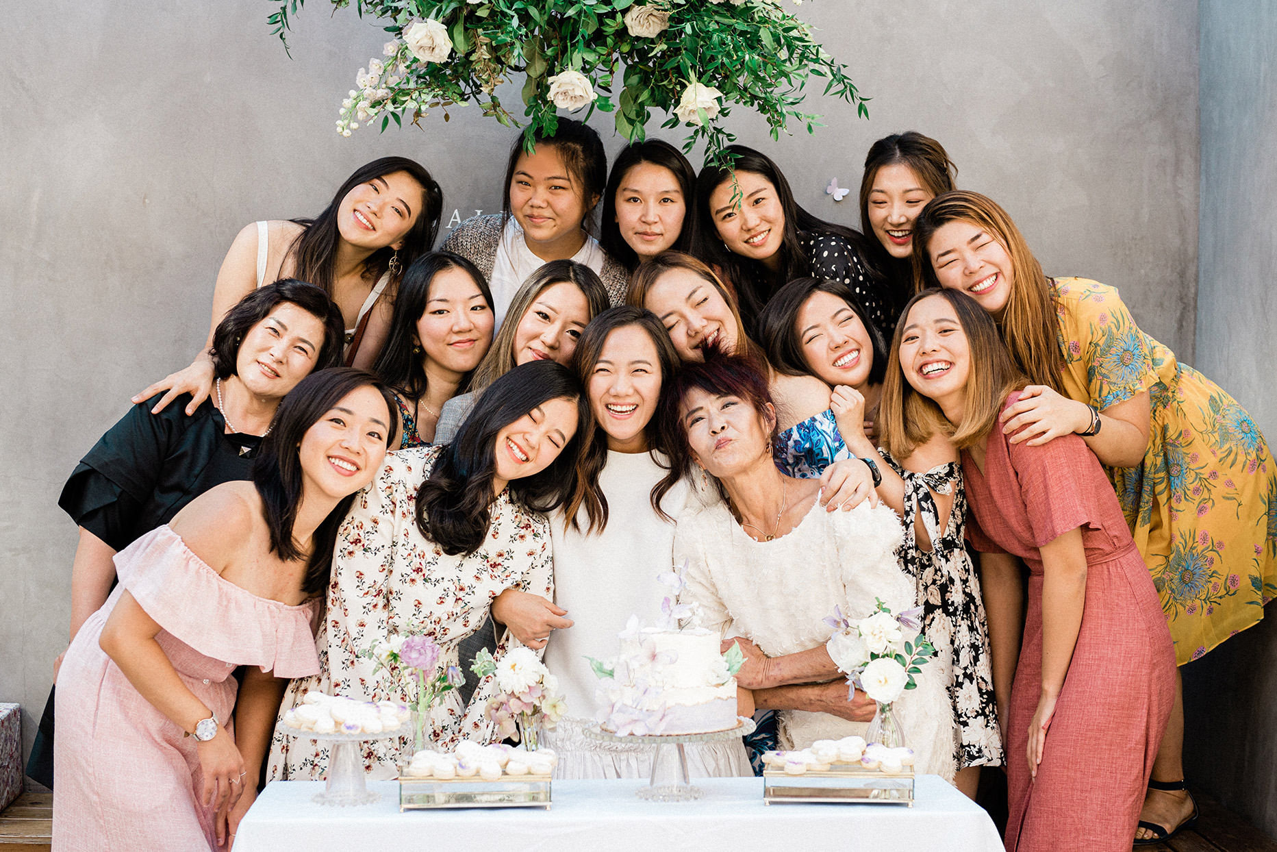 sally bridal shower group photo in front of desserts