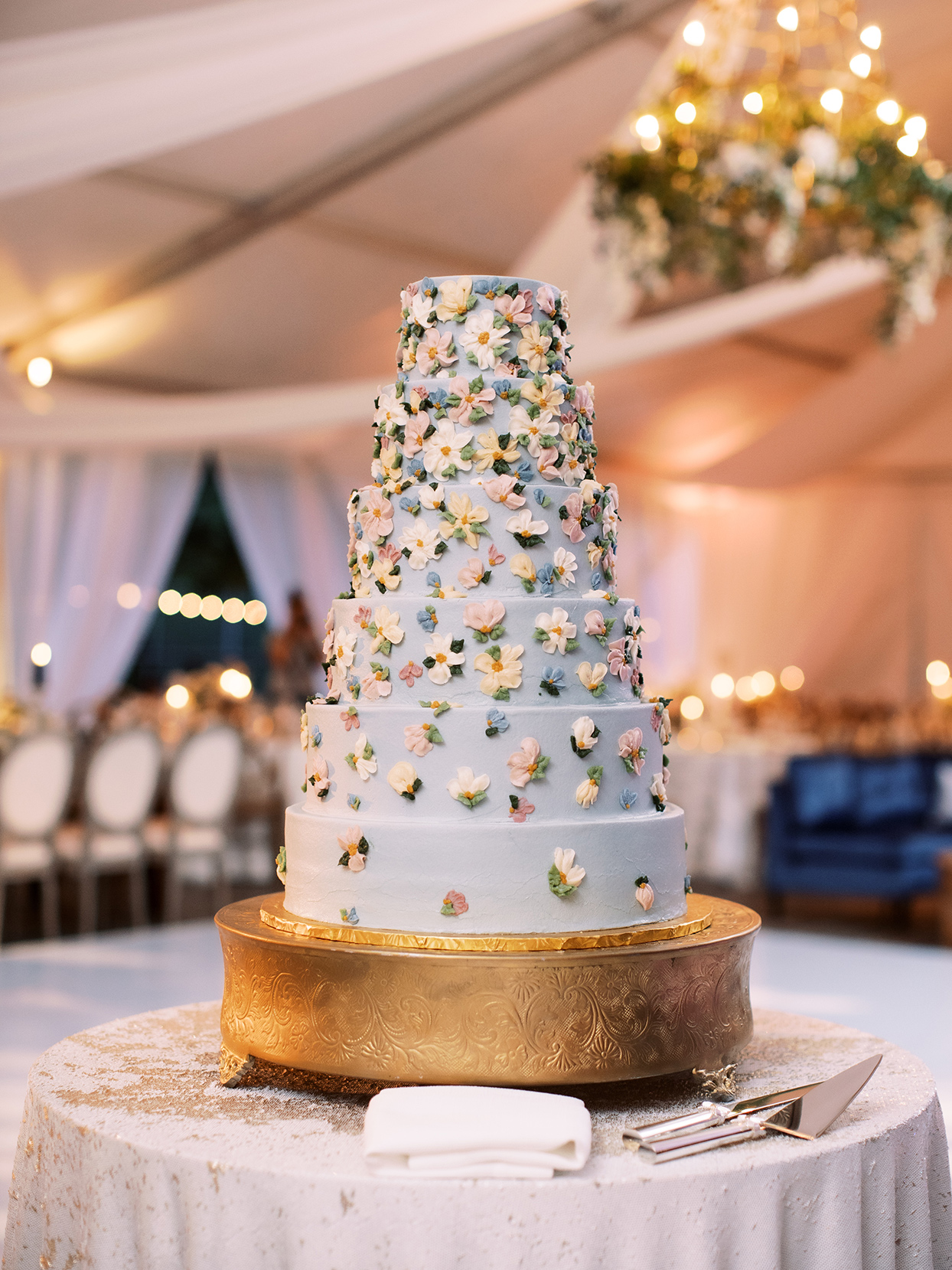 lauren chris wedding cake with floral decorations on gold stand