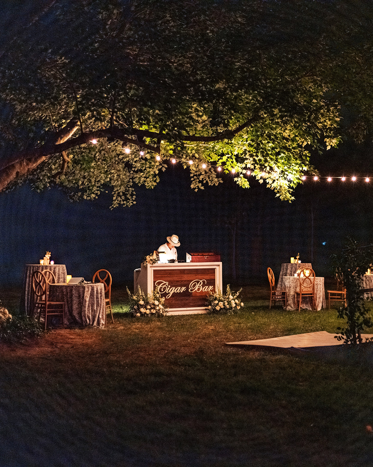 lauren chris wedding cigar bar lit under trees