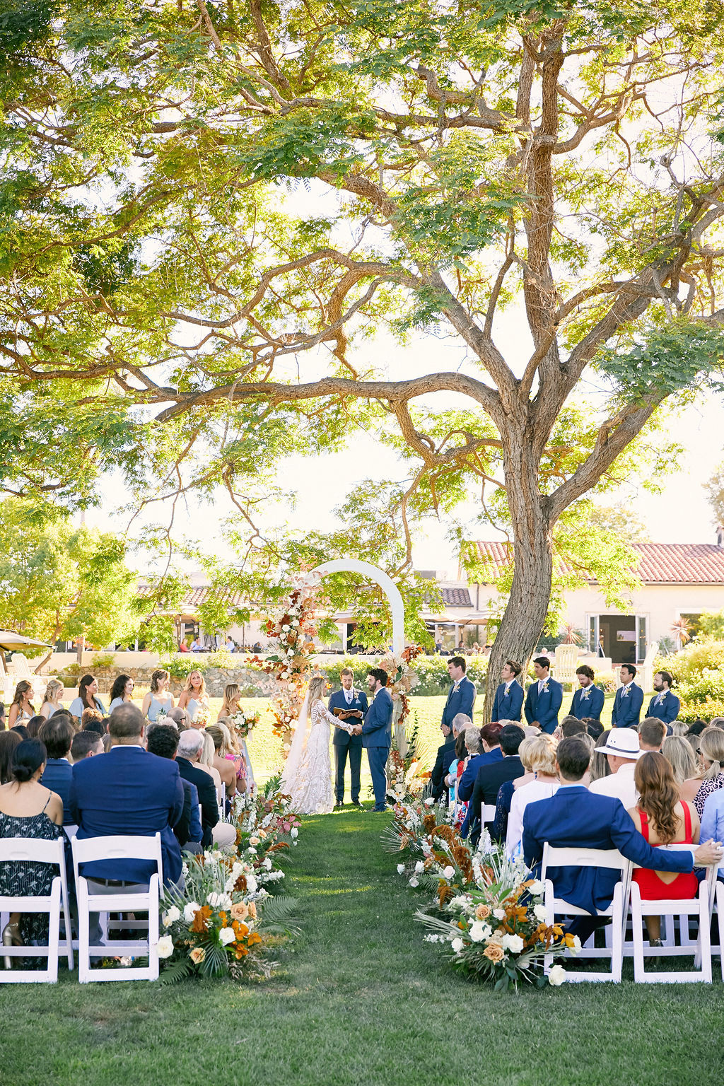 sara trisdan wedding ceremony on lawn