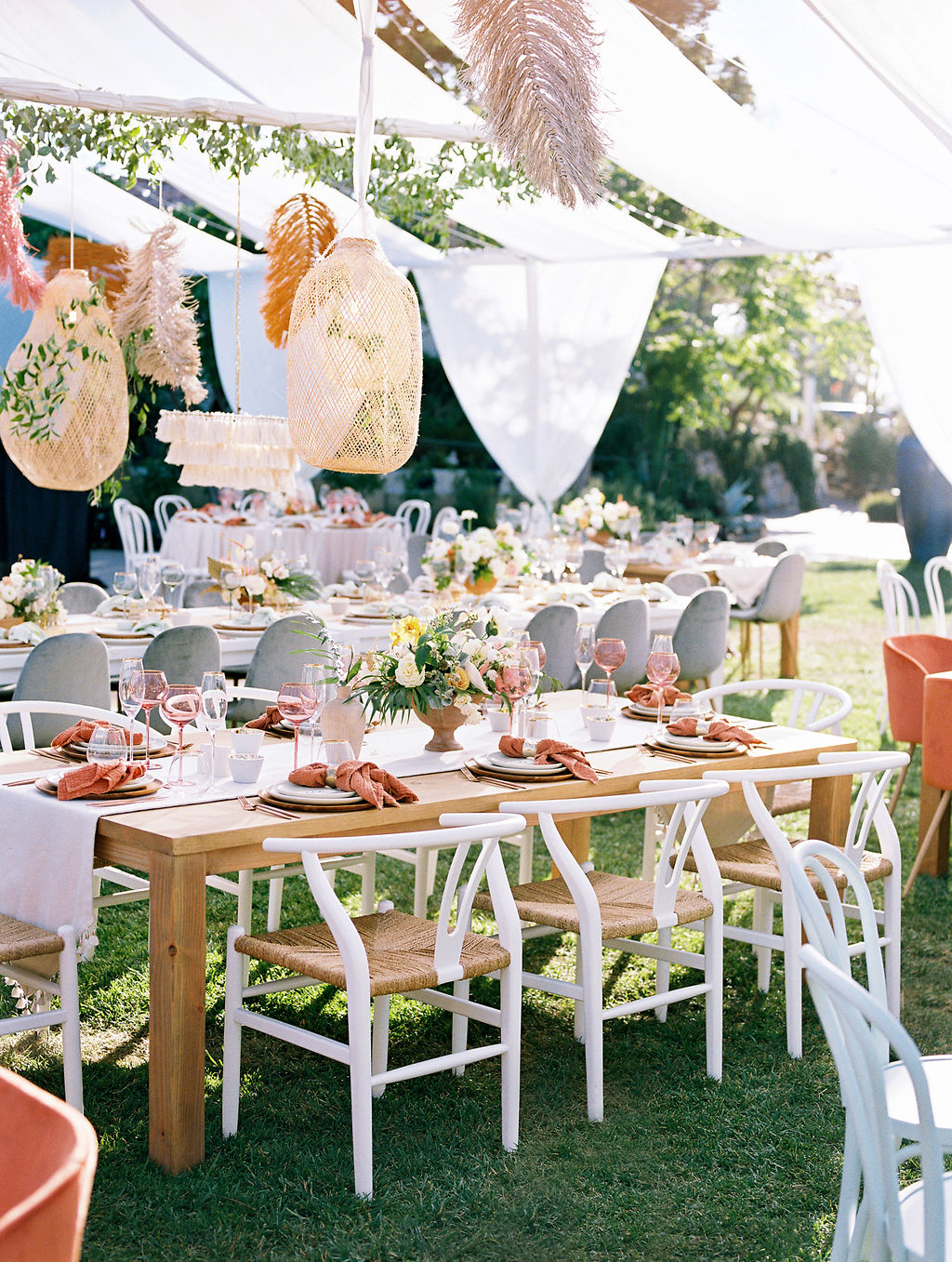 sara trisdan wedding outdoor reception set up with wicker seated chairs