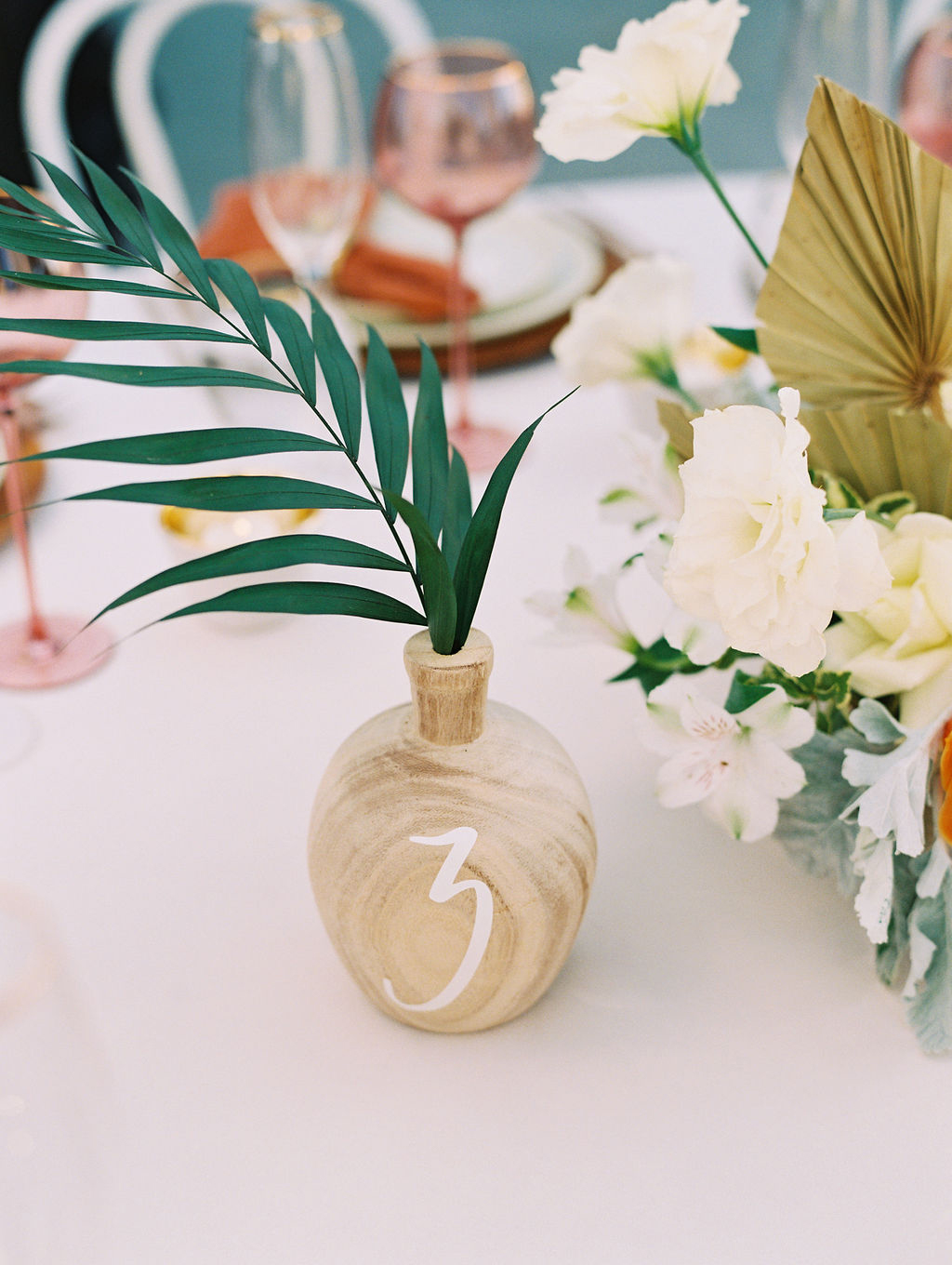 sara trisdan wedding wooden vase table number with greenery