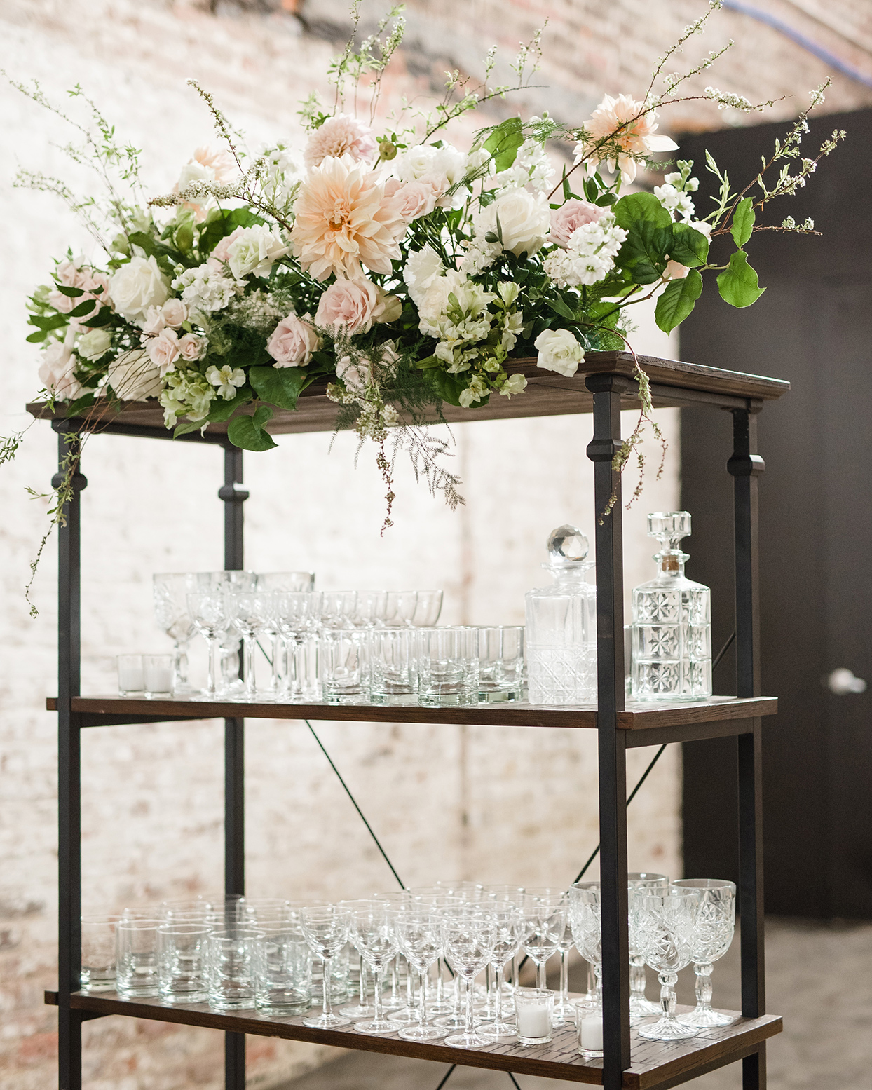 Wooden display with glasses and flowers