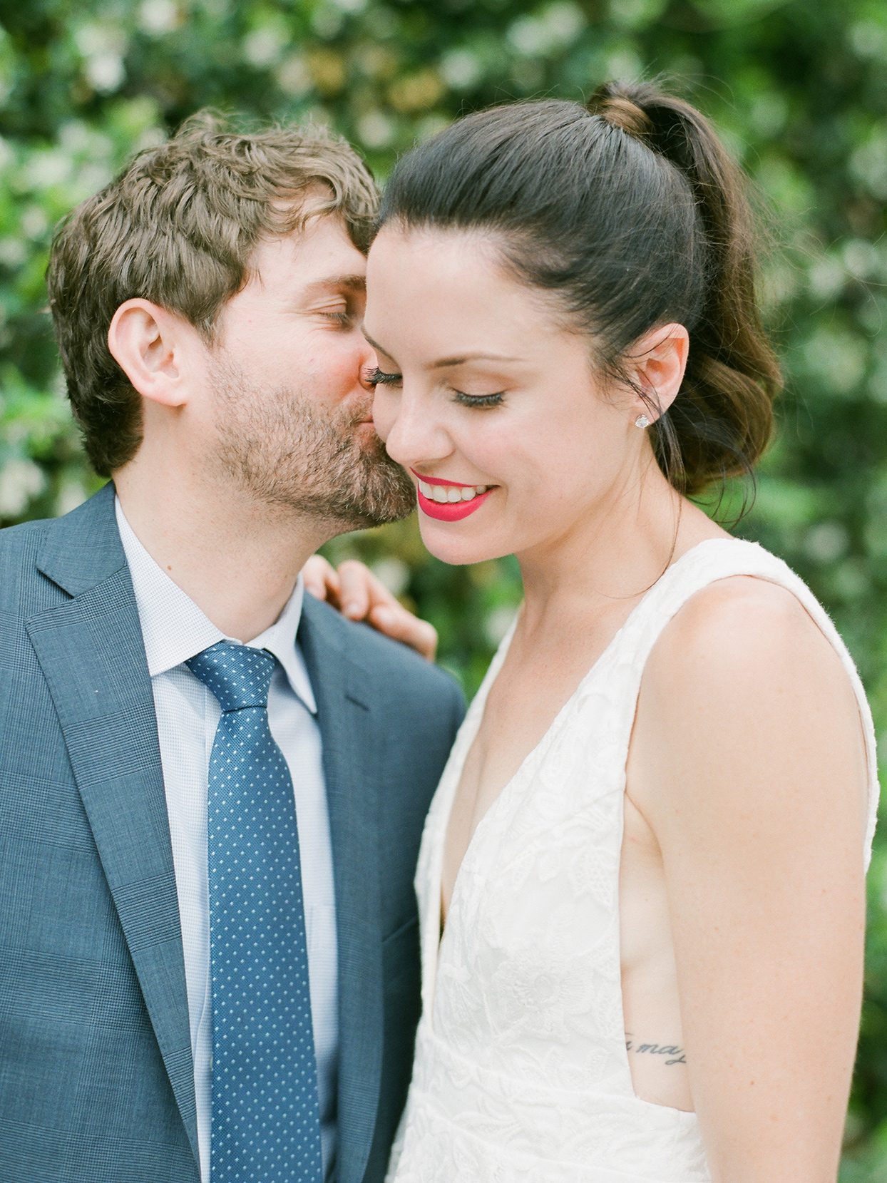 Close up of groom kissing bride