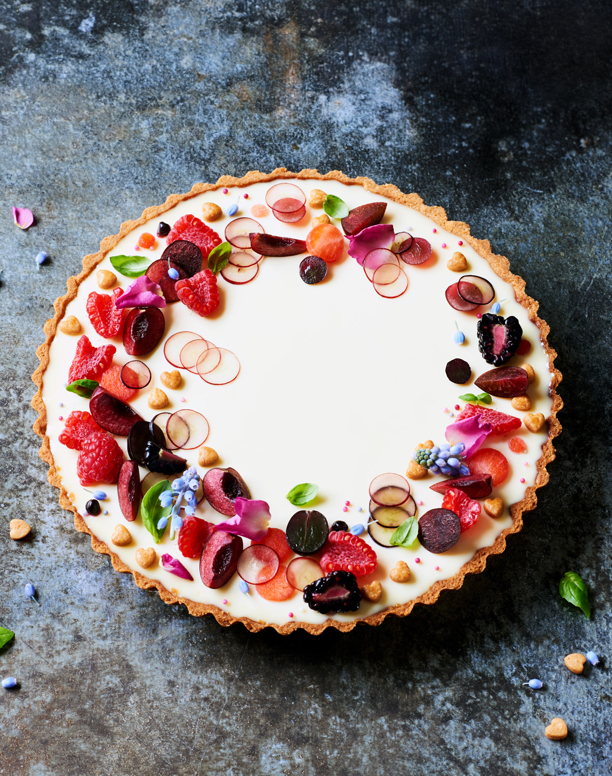 chamomile panna-cotta tart topped with edible flowers