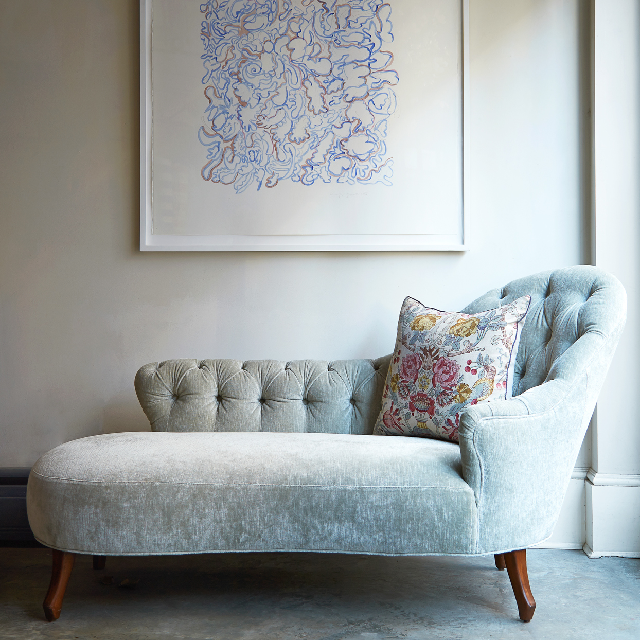 gray chaise with modern decor and floral pillow