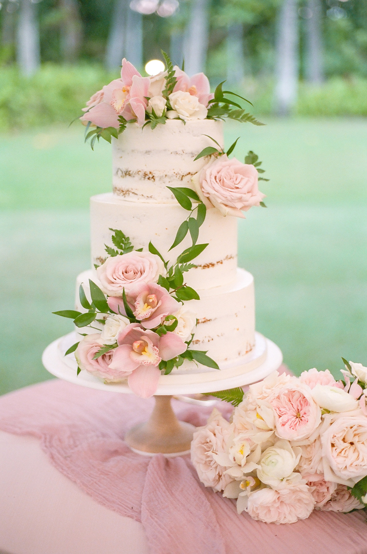 light pink wedding cake with flowers