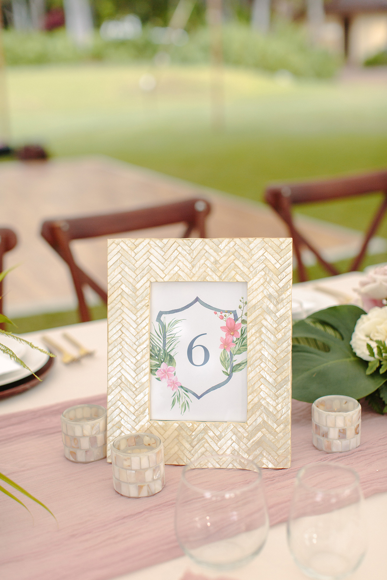 vanessa nathan wedding crest table number in gold frame on table