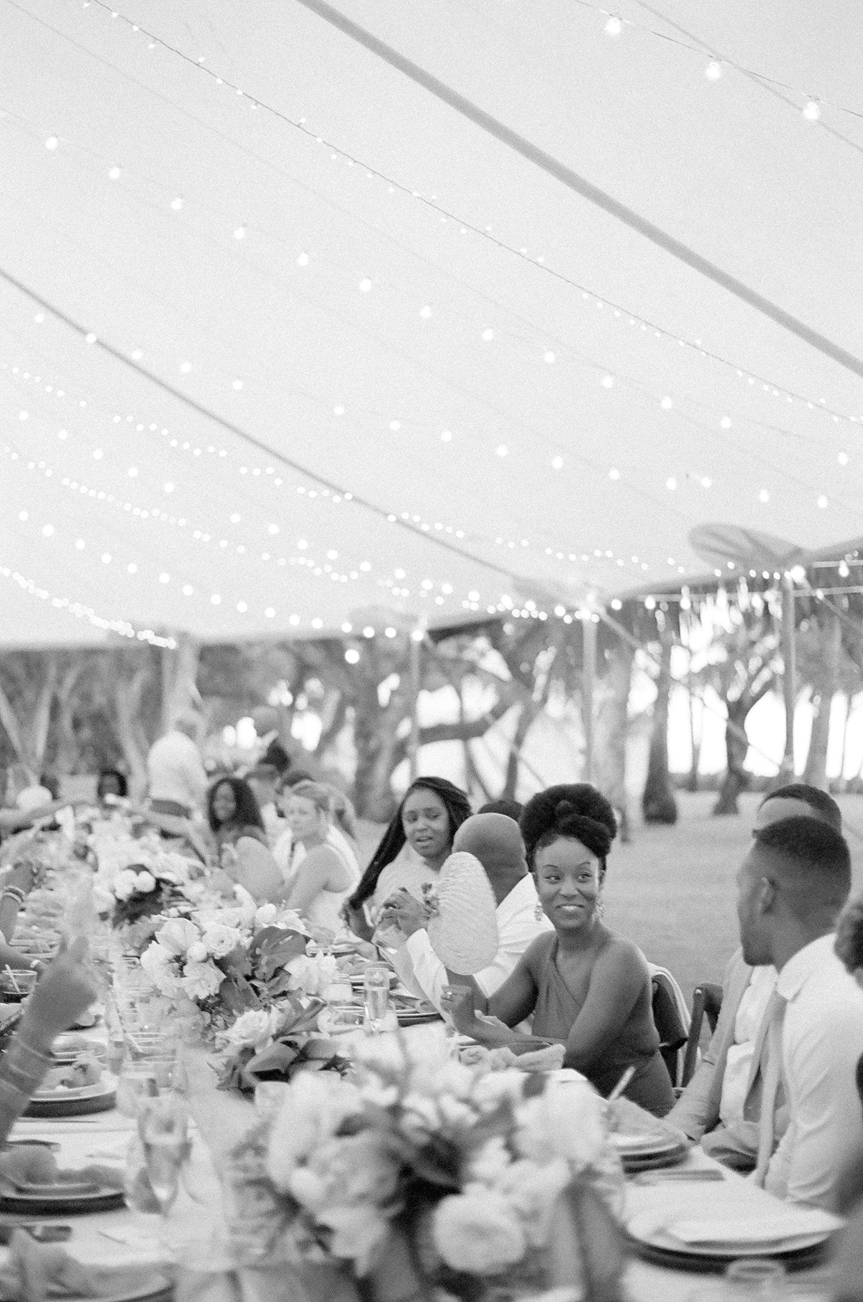 vanessa nathan wedding reception guests at long table during dinner