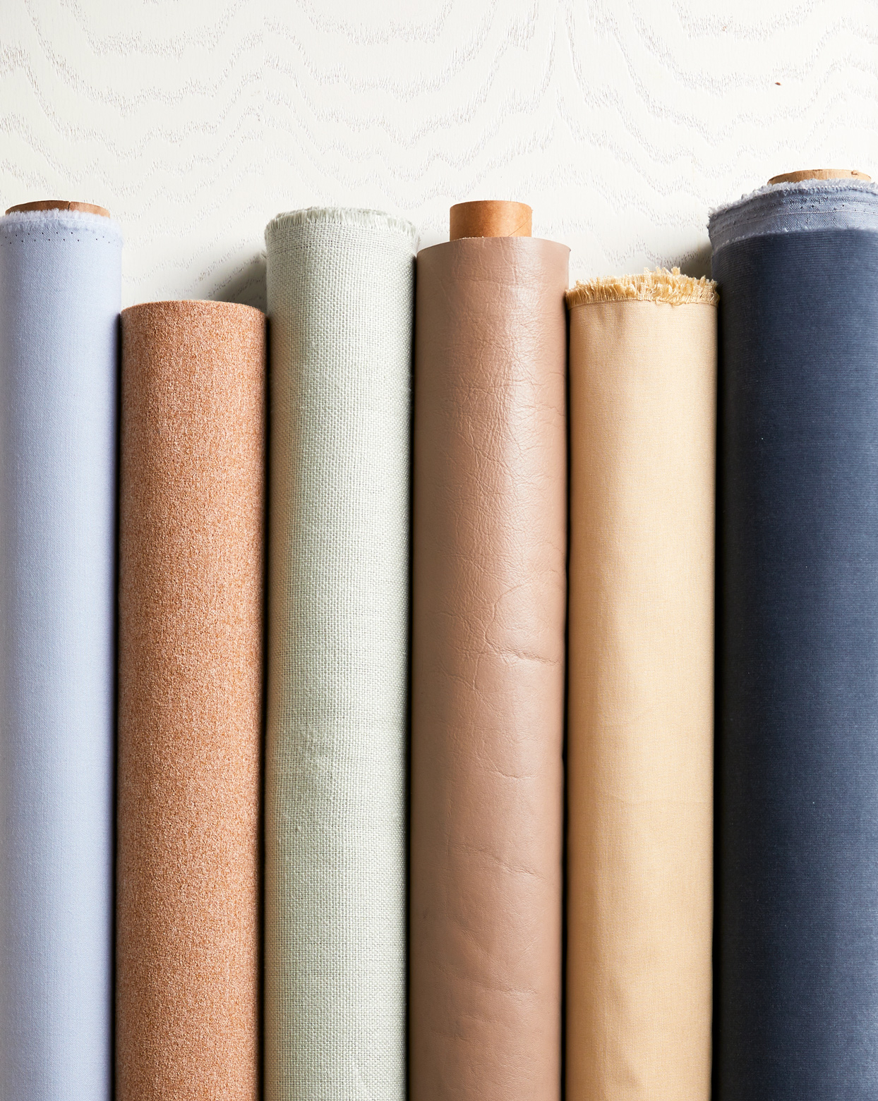 various colored types of fabric rolls