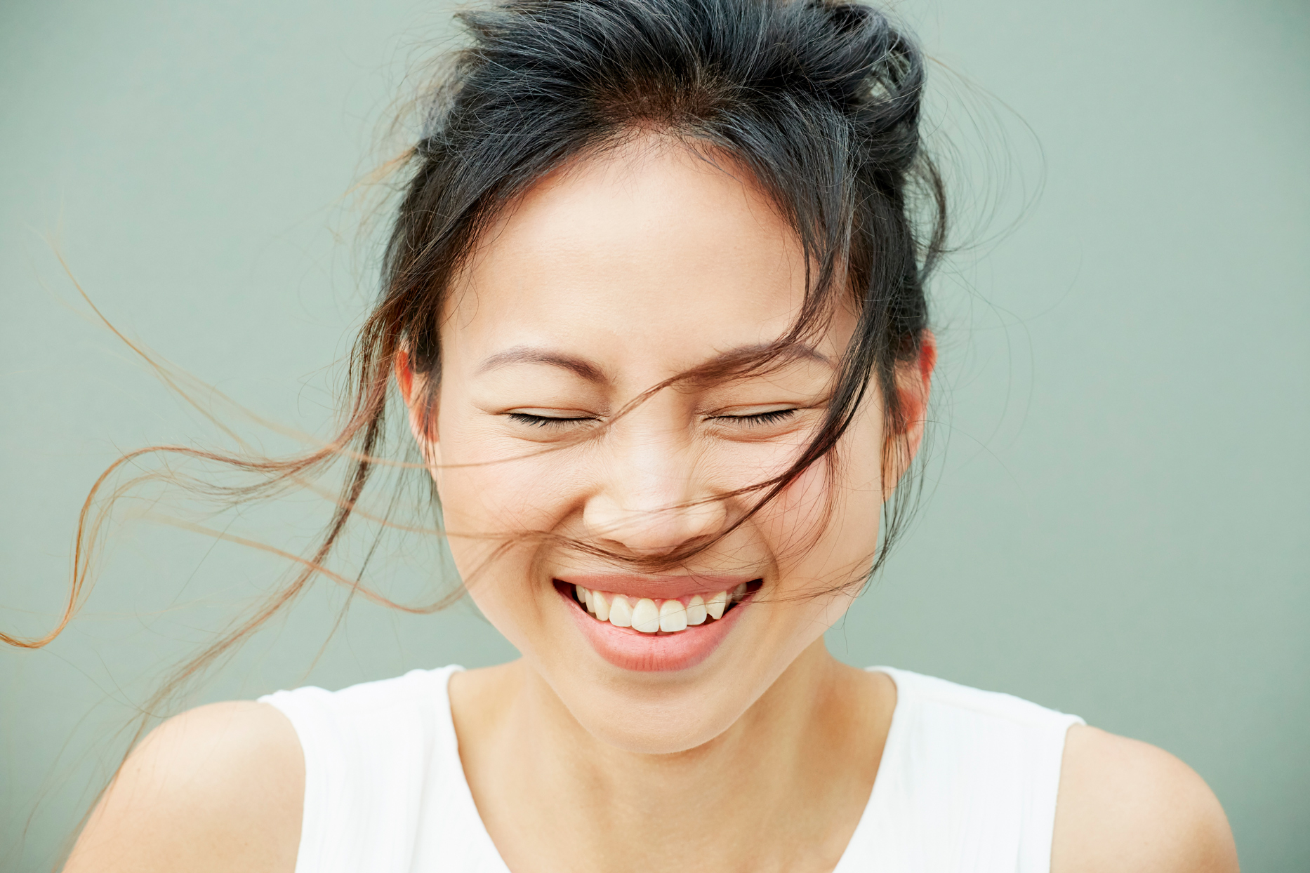 woman smiling with hair blowing in her face