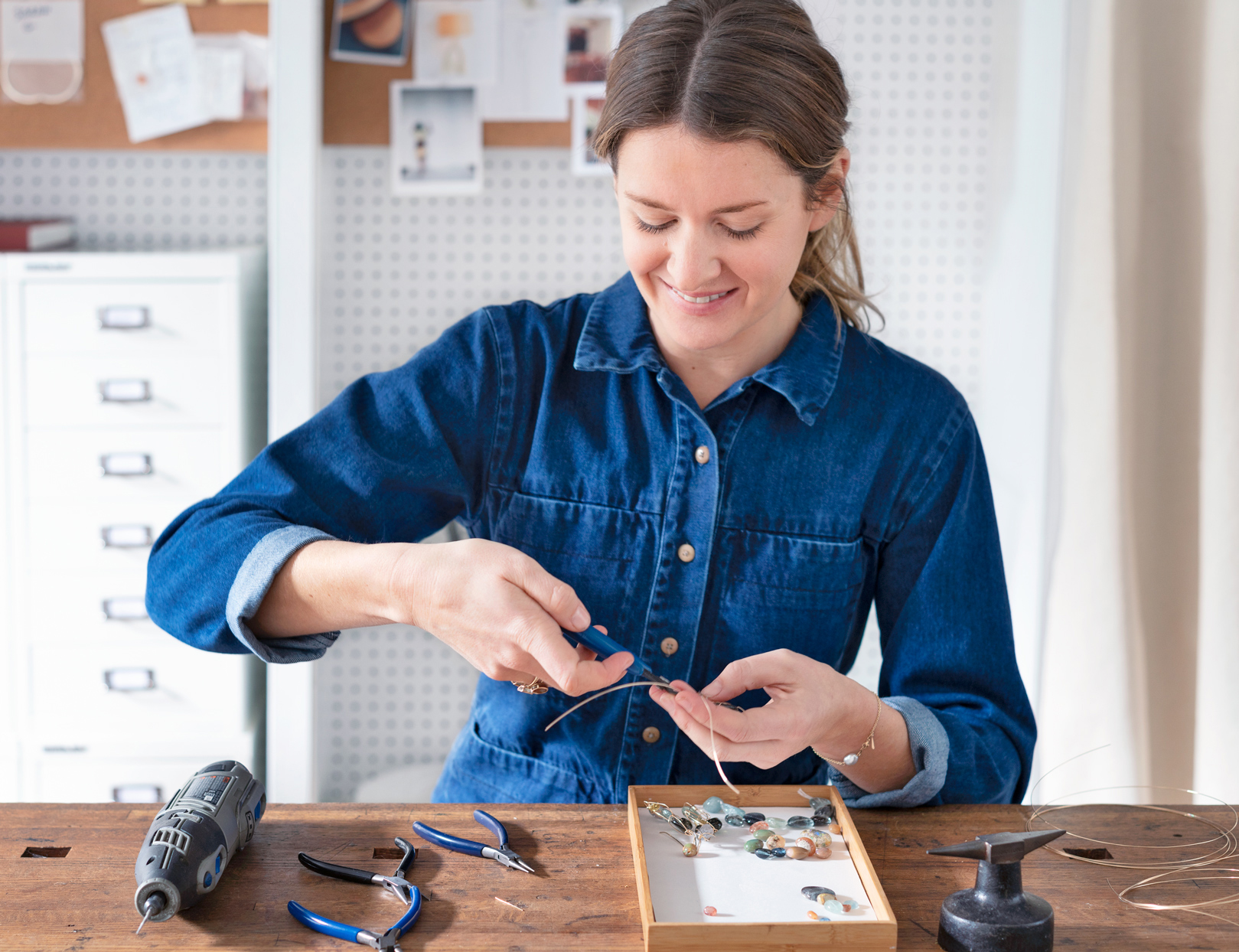 mary macgill making jewelry in store studio space