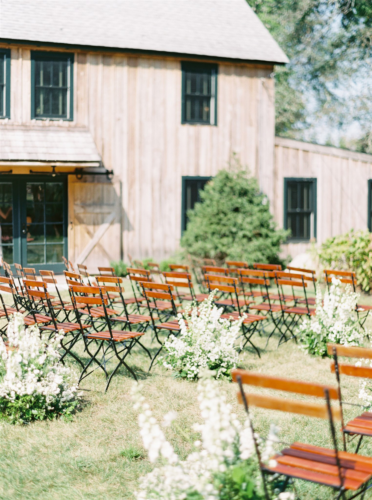 samantha cody wedding ceremony wooden chairs set up outside
