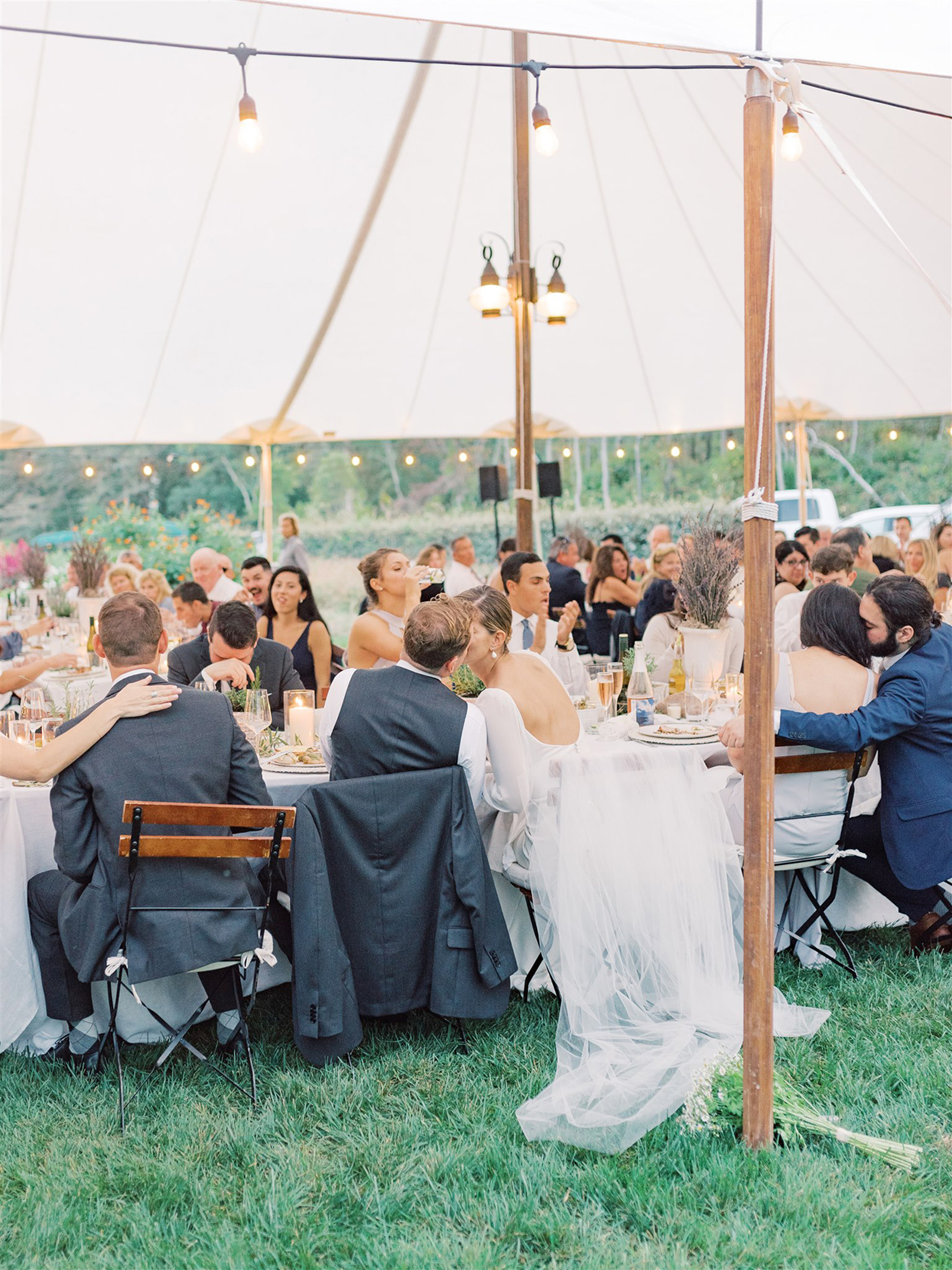 samantha cody wedding couple kissing at reception table with guests