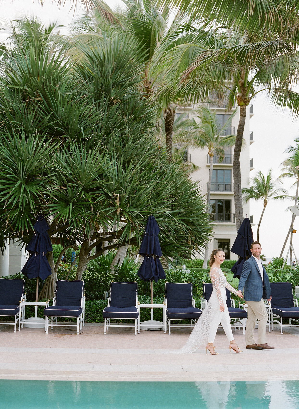 brittany brian wedding couple walking by pool