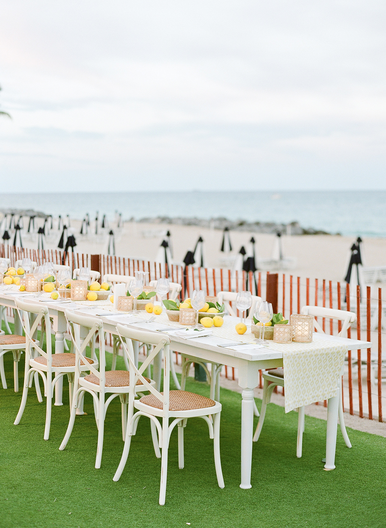 wedding rehearsal dinner table set up by the beach