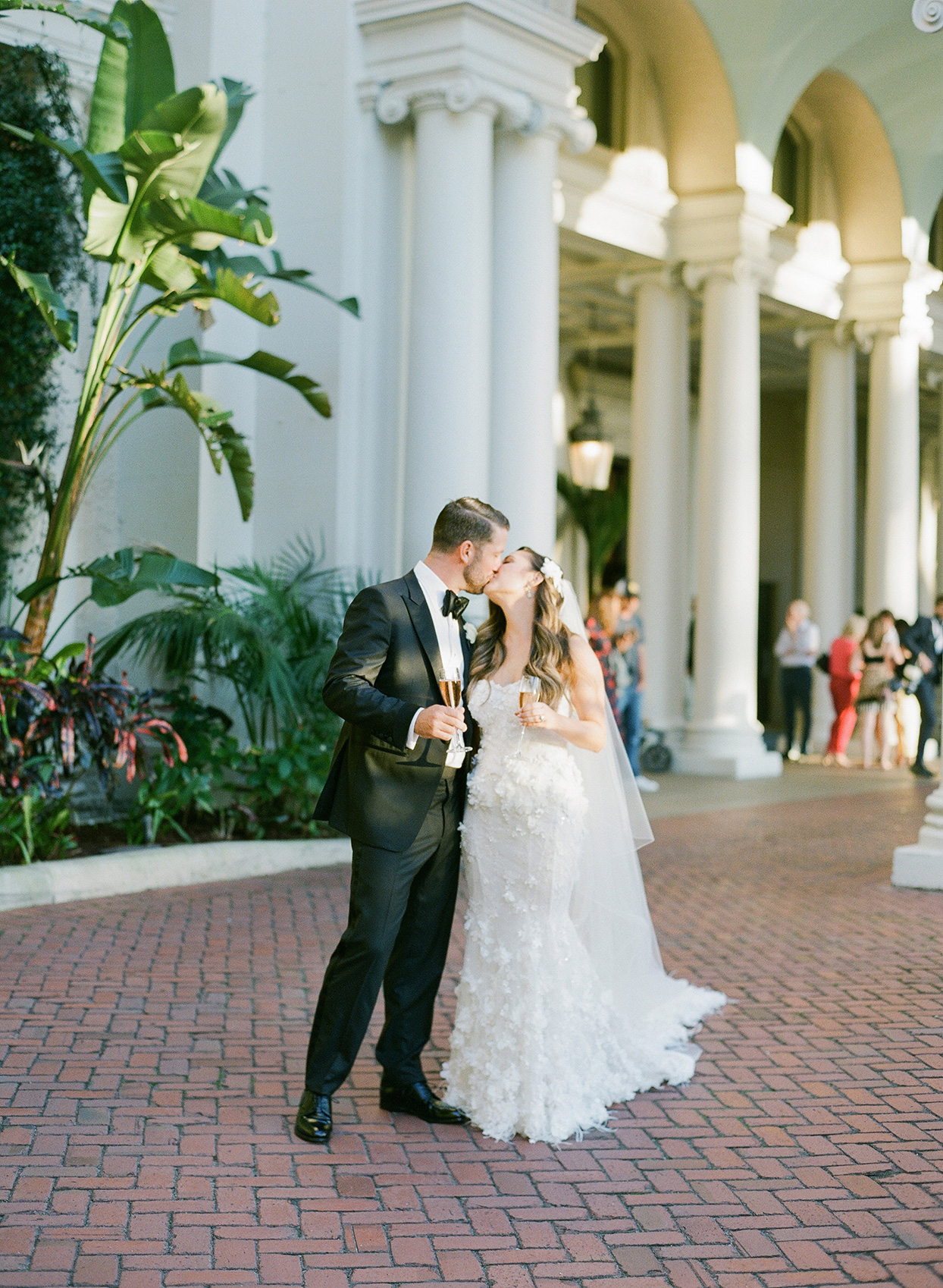 brittany brian wedding couple kissing outside on brick road