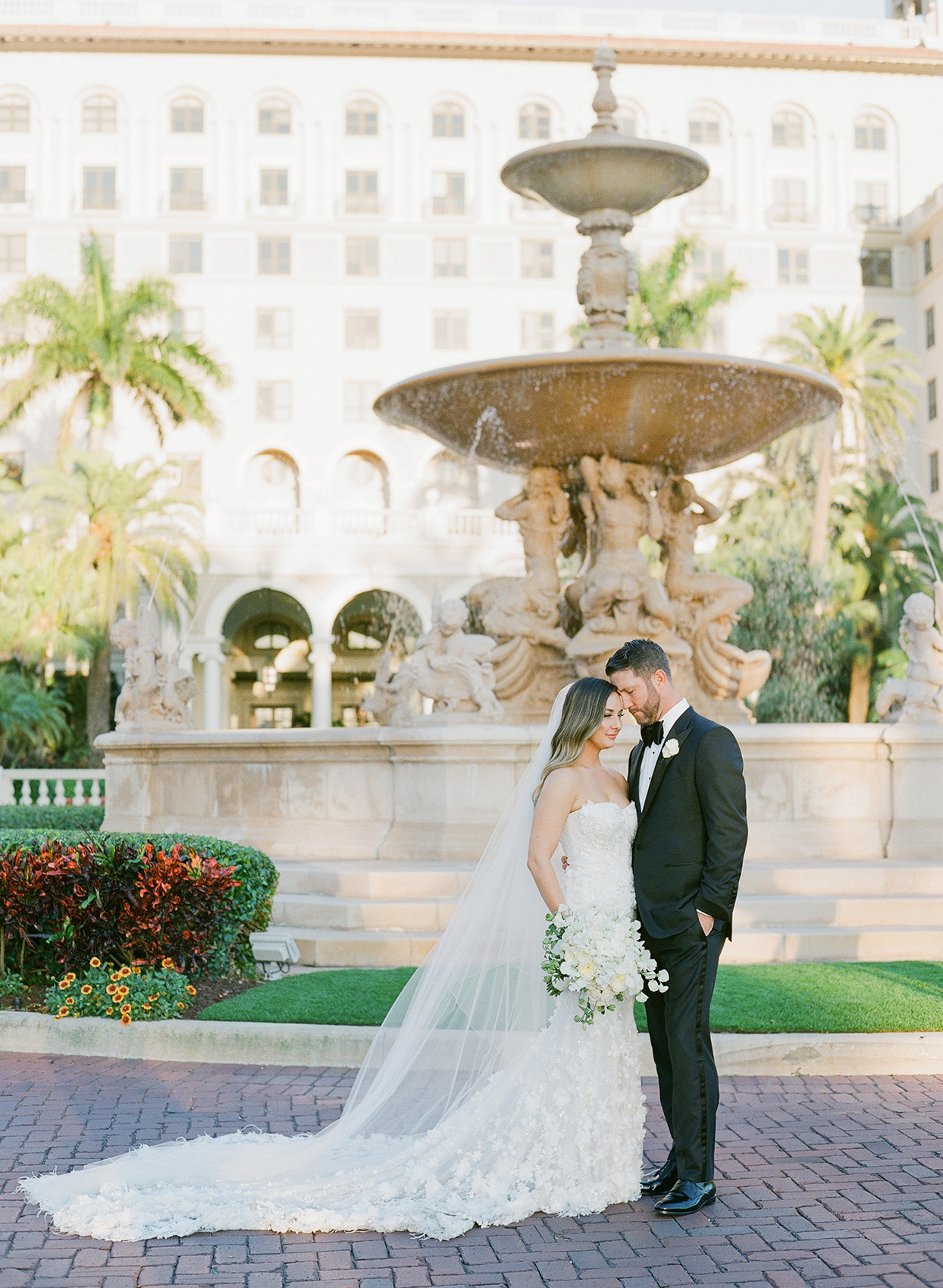 brittany brian wedding couple posing in front of fountain at first look