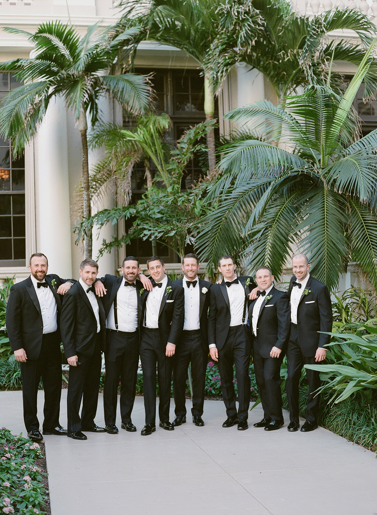 brittany brian wedding groomsmen on pathway surrounded by tropical plants