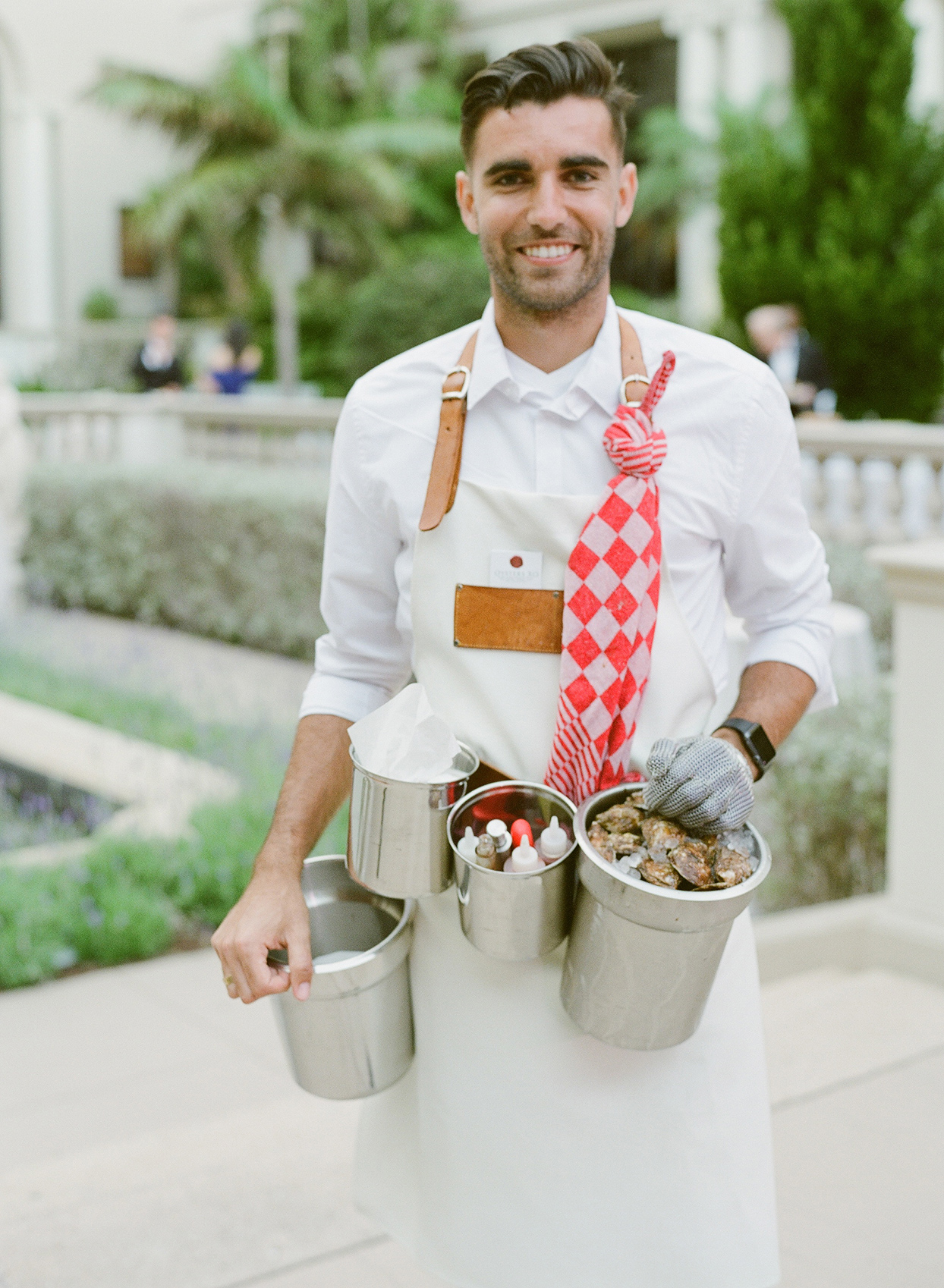 brittany brian wedding server wearing oyster buckets belt