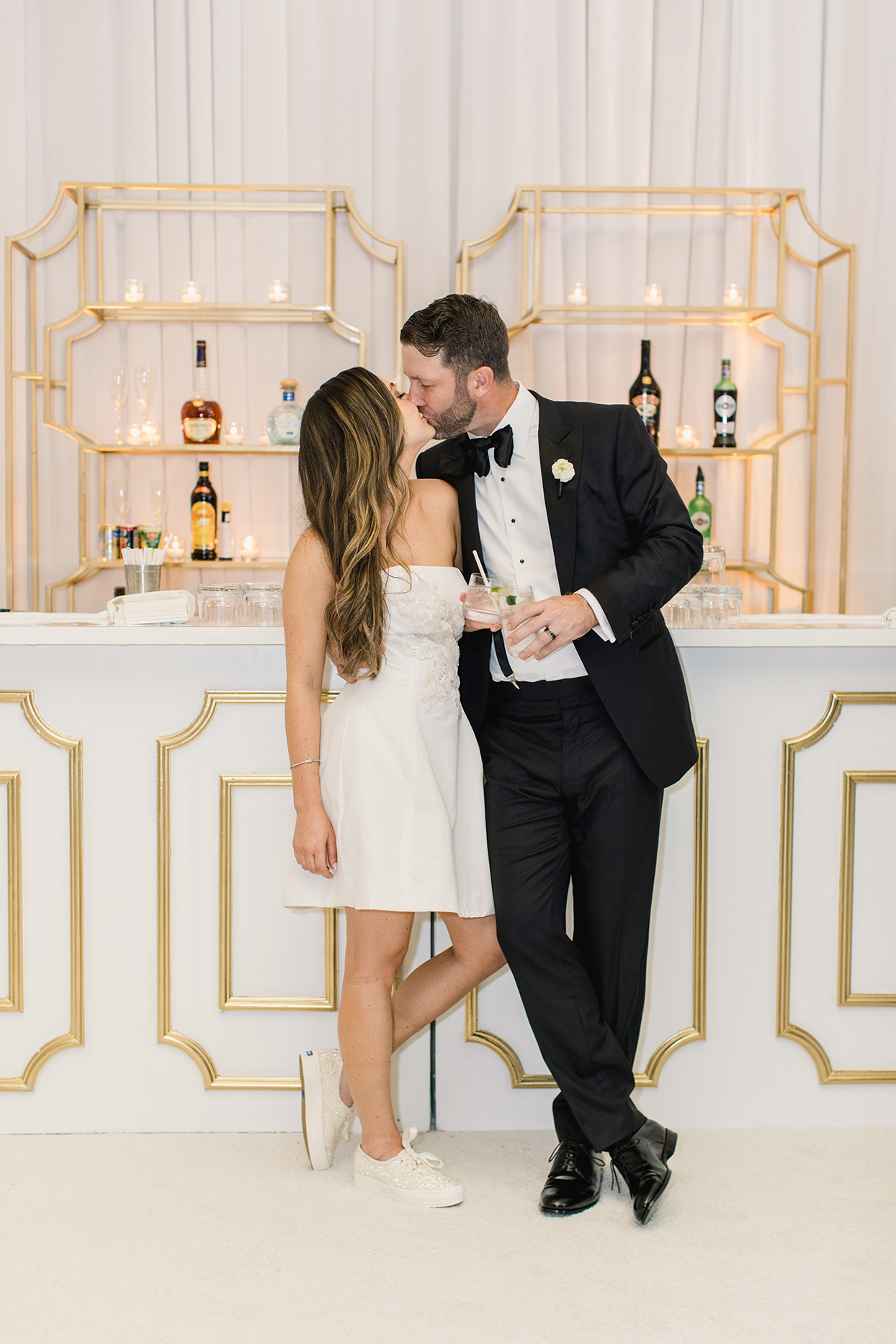 brittany brian wedding reception bride in short dress kissing groom at bar