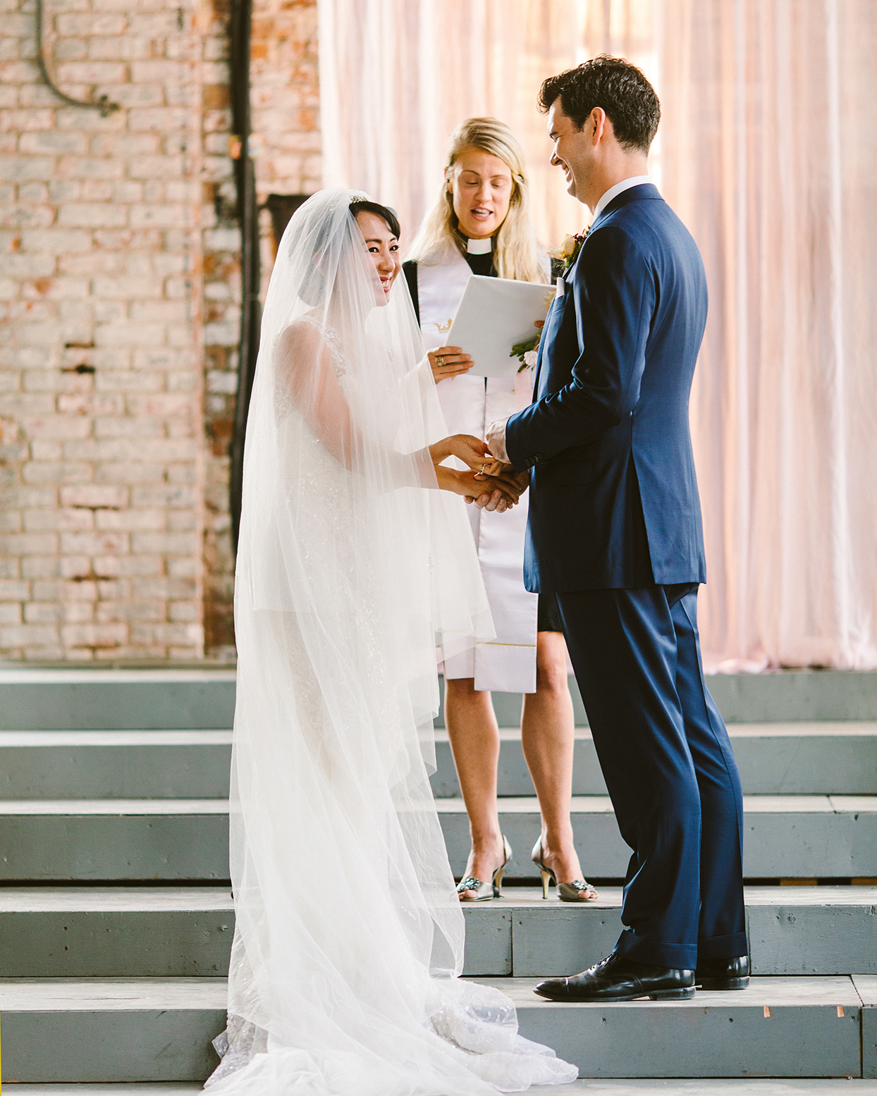 bride and groom and officiant during ceremony