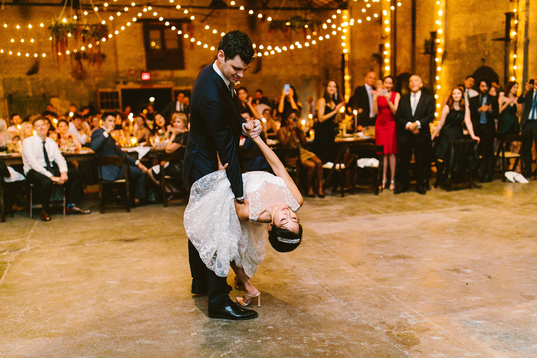 bride and groom dip during first dance