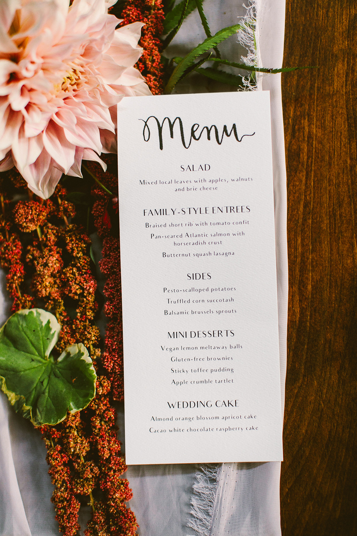reception menu on table with floral garland