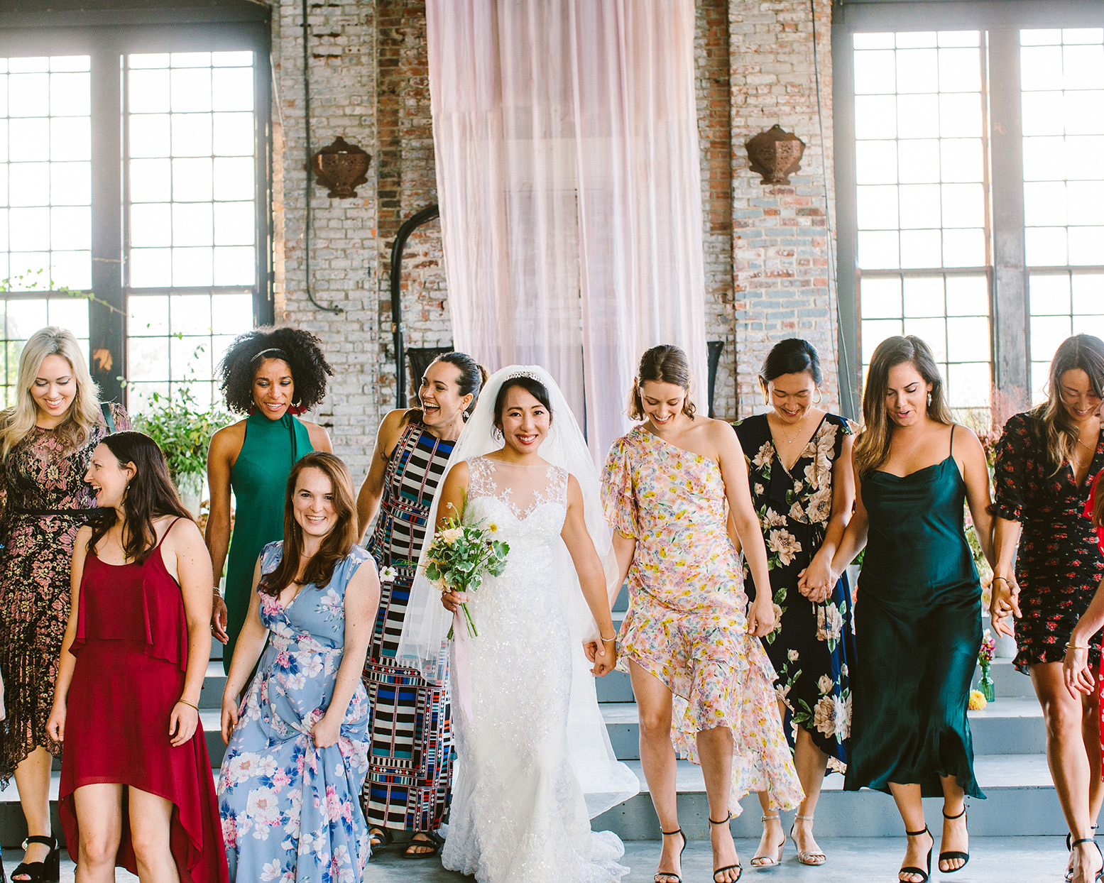 bride during wedding with woman in diverse outfits