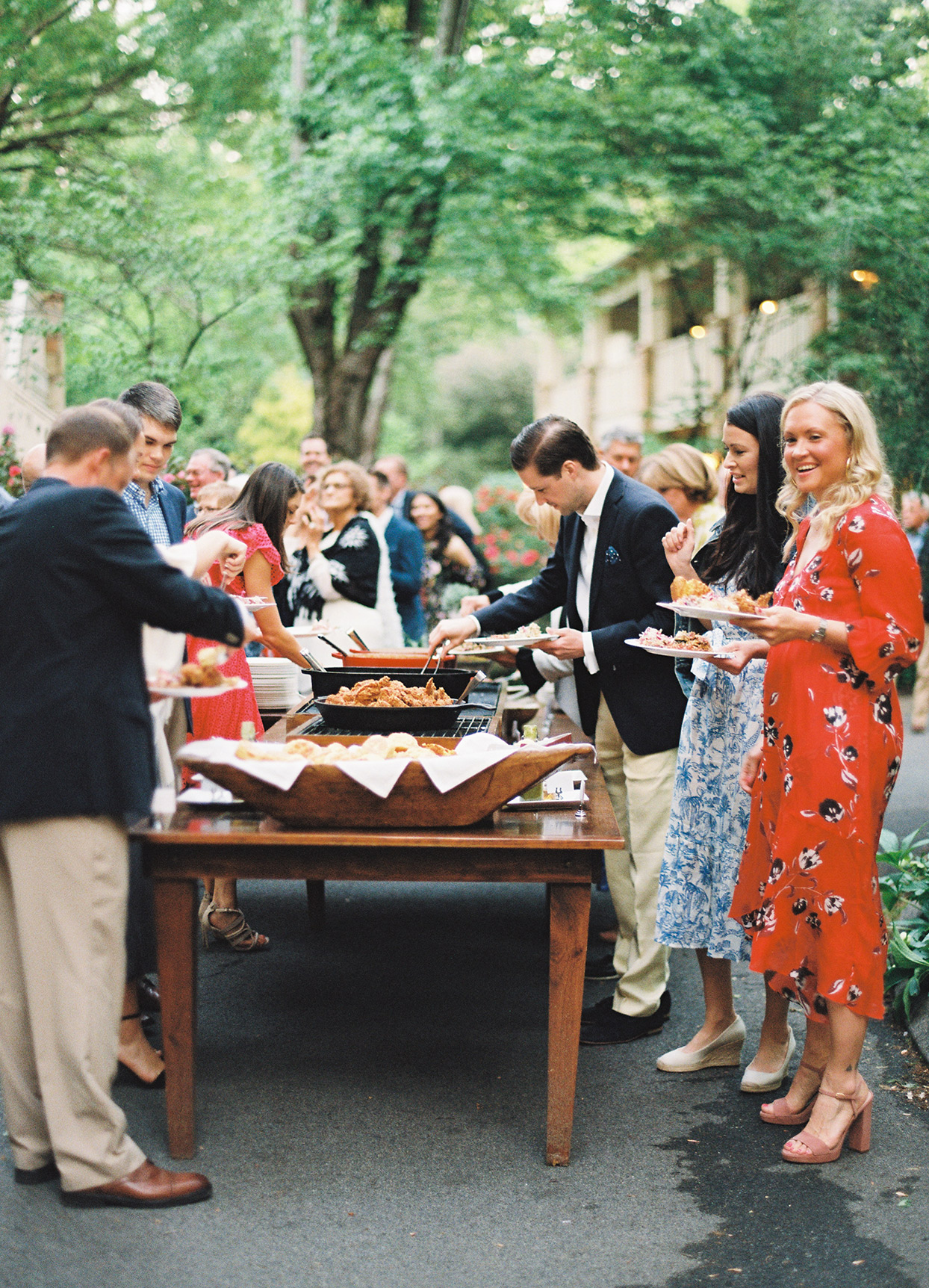 guests walking through buffet at welcome party