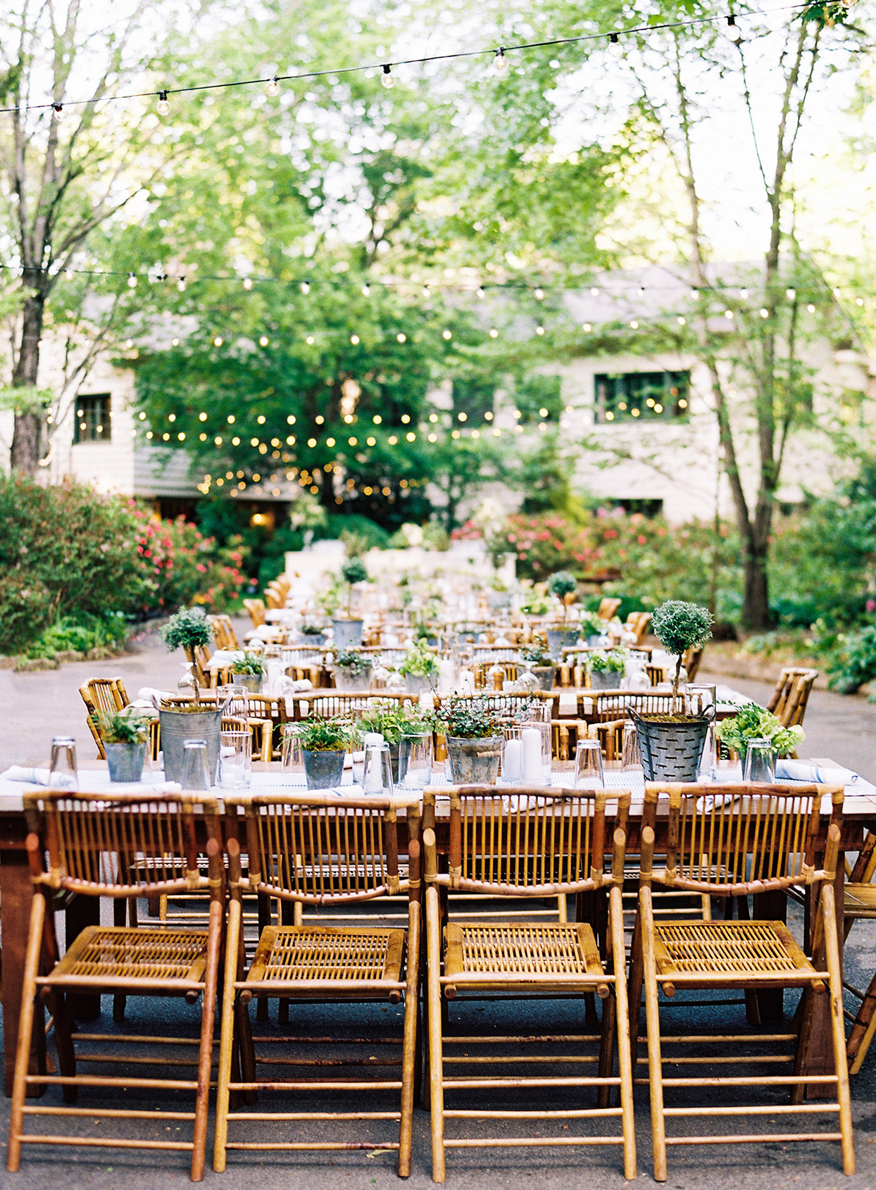 elegant rustic welcome party tables set up in driveway