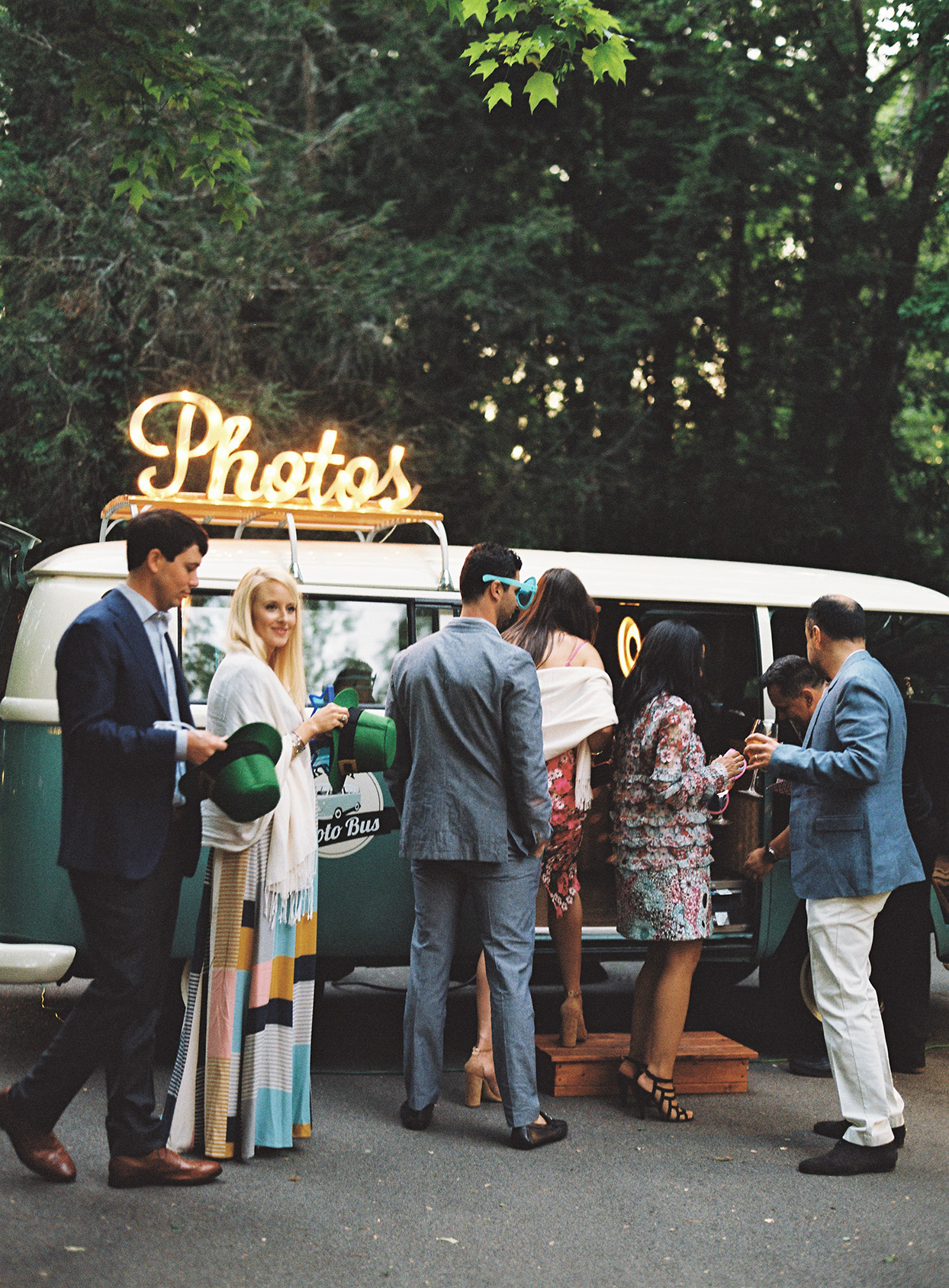 guests getting in photo booth van at welcome party