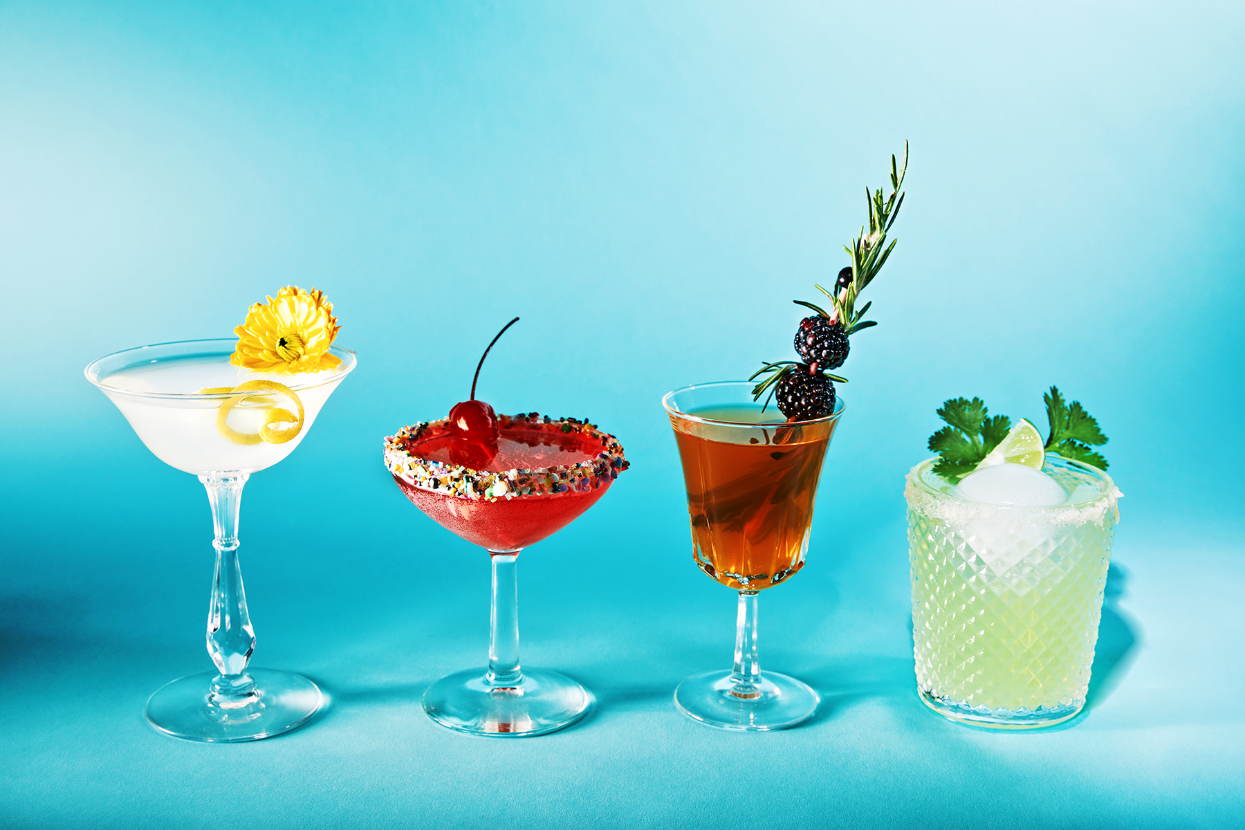 4 cocktails showing selection of cocktail garnishes