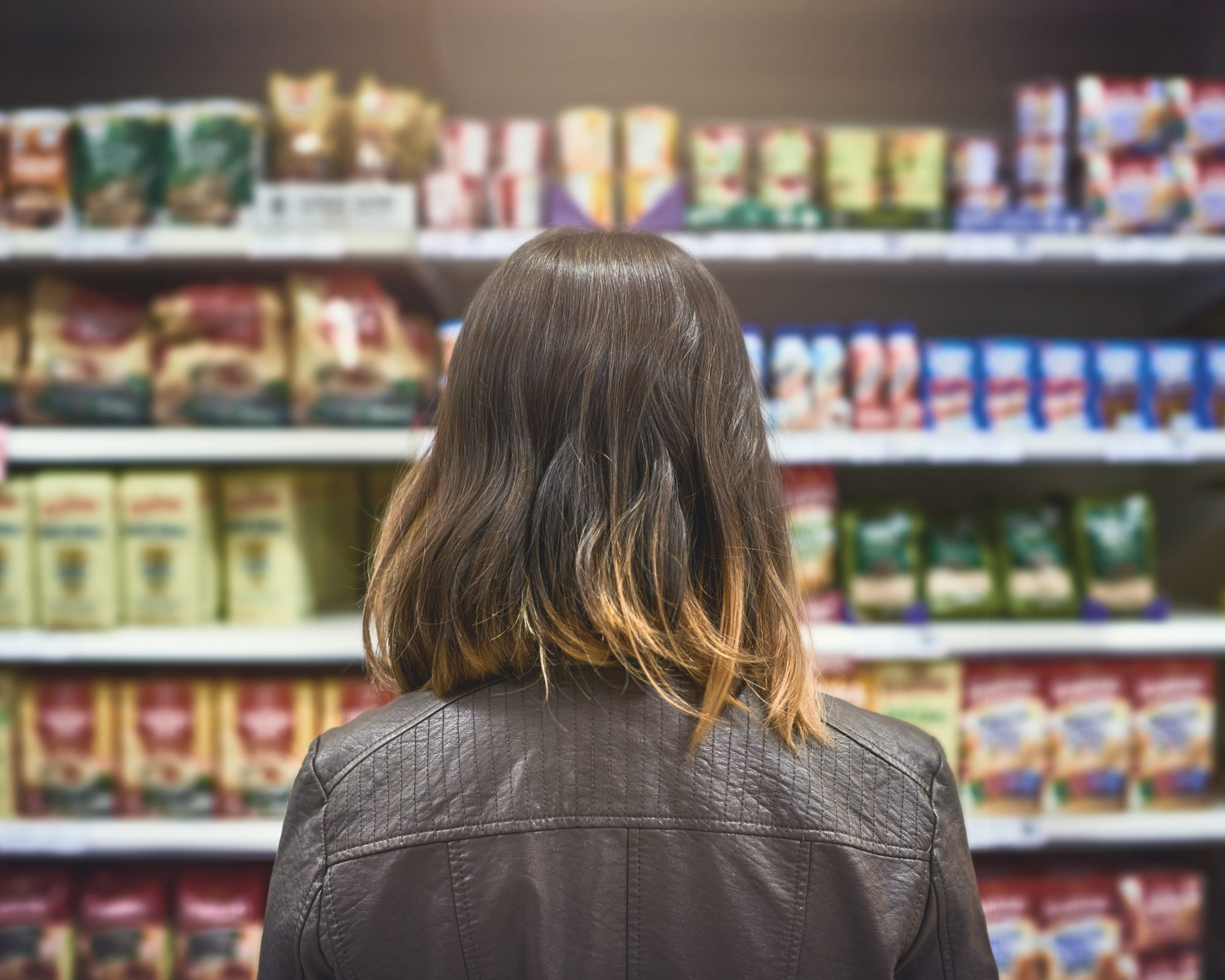 woman in supermarket aisle