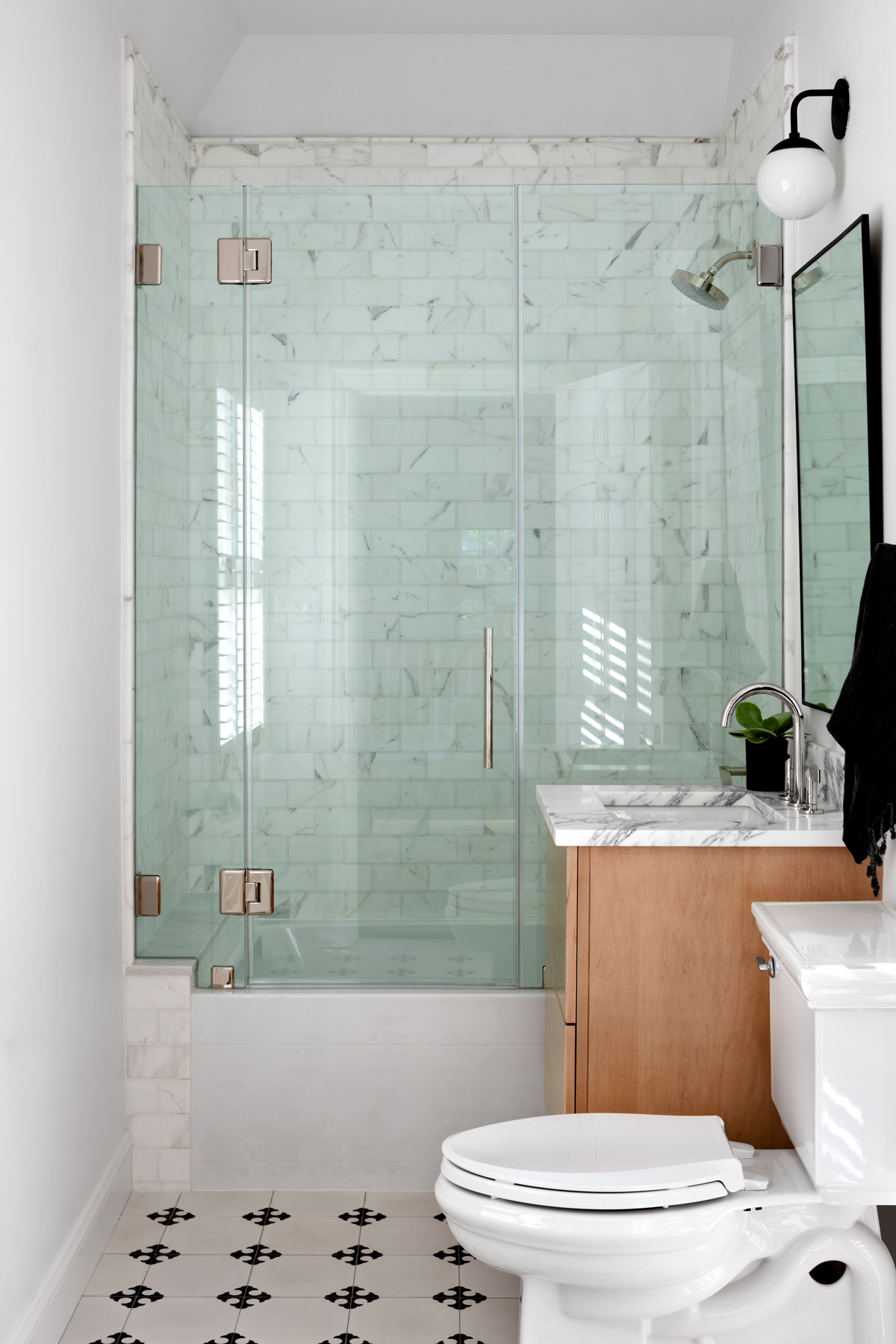 Cle tile bathroom floor and Calacatta subway tile shower walls