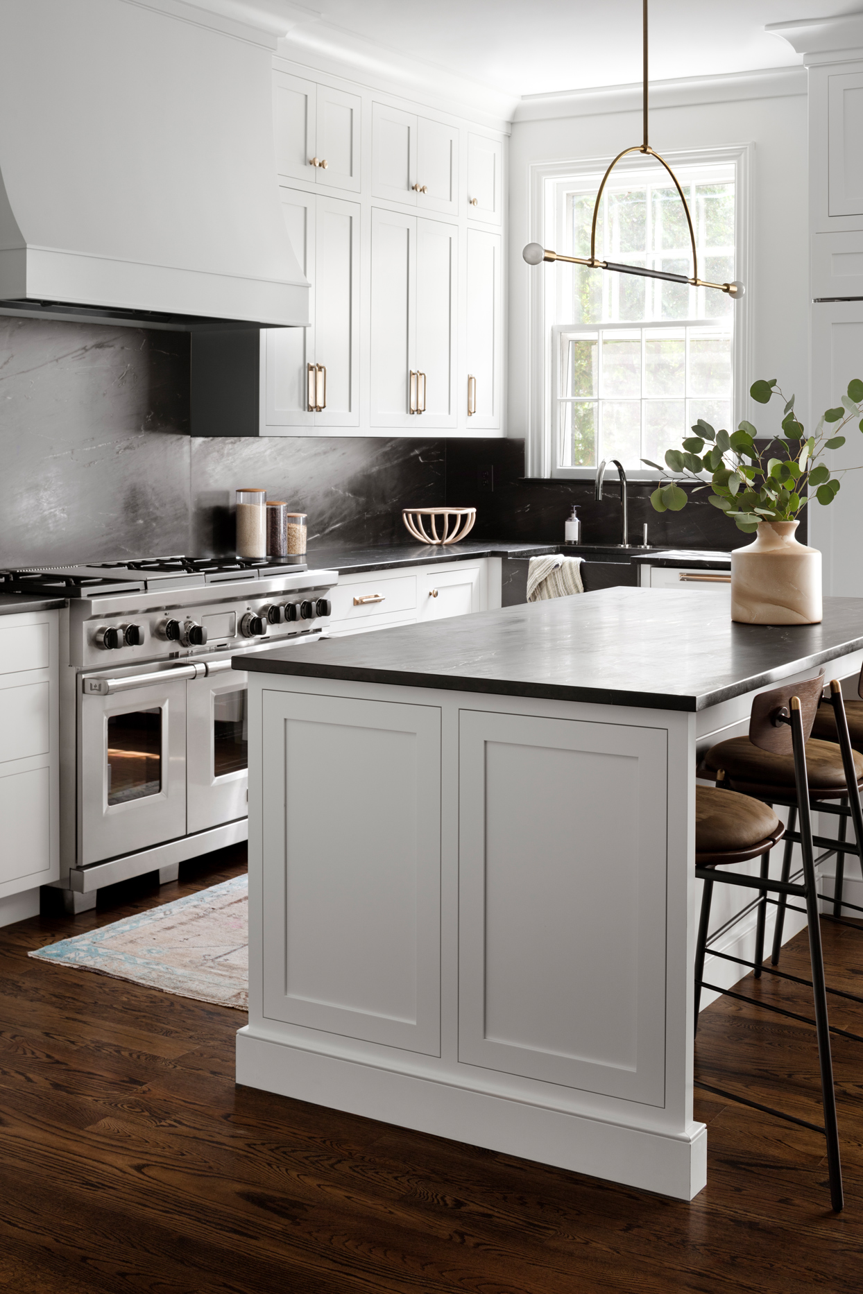 white cabinet black countertop kitchen