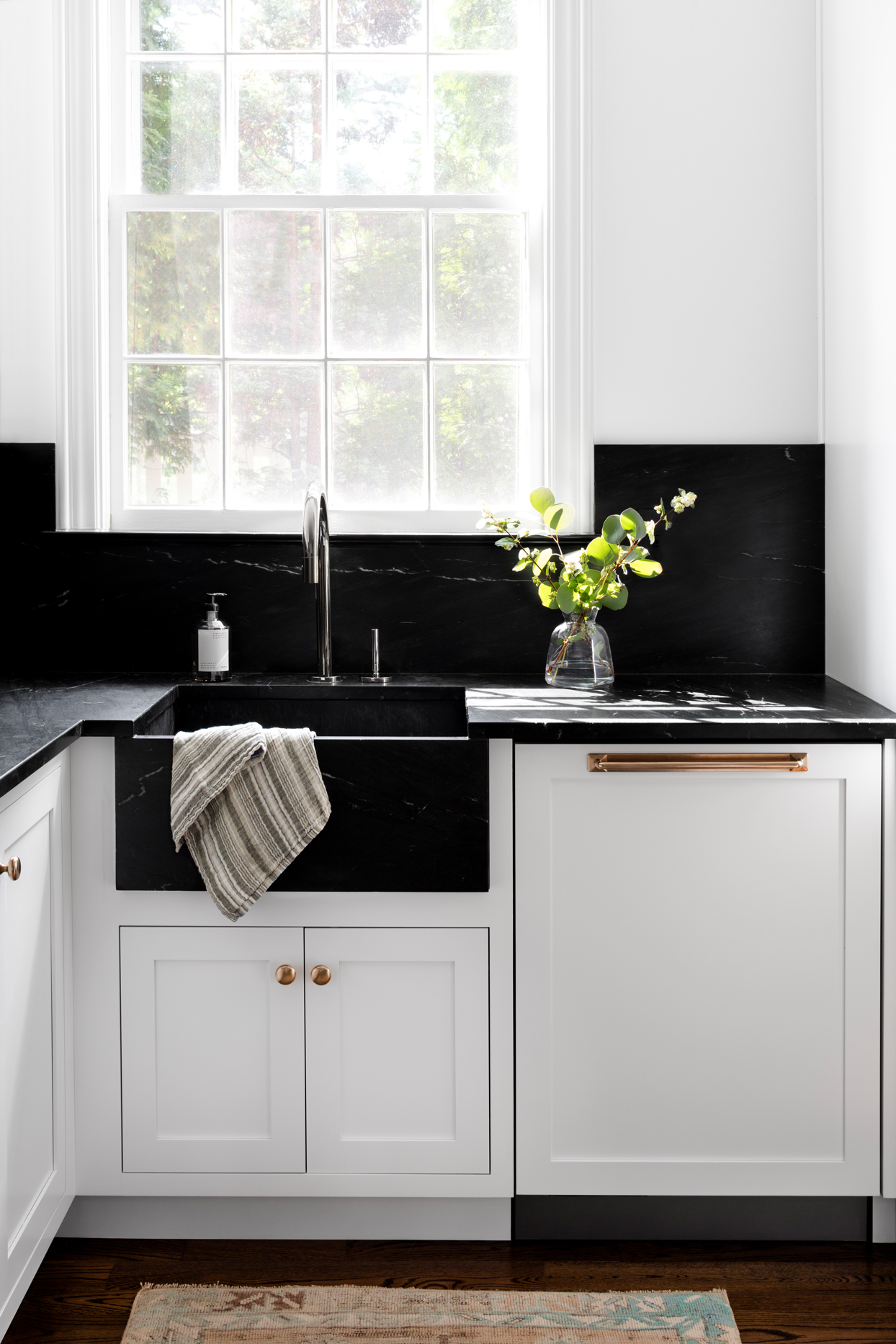 deep black marble kitchen sink white cabinets