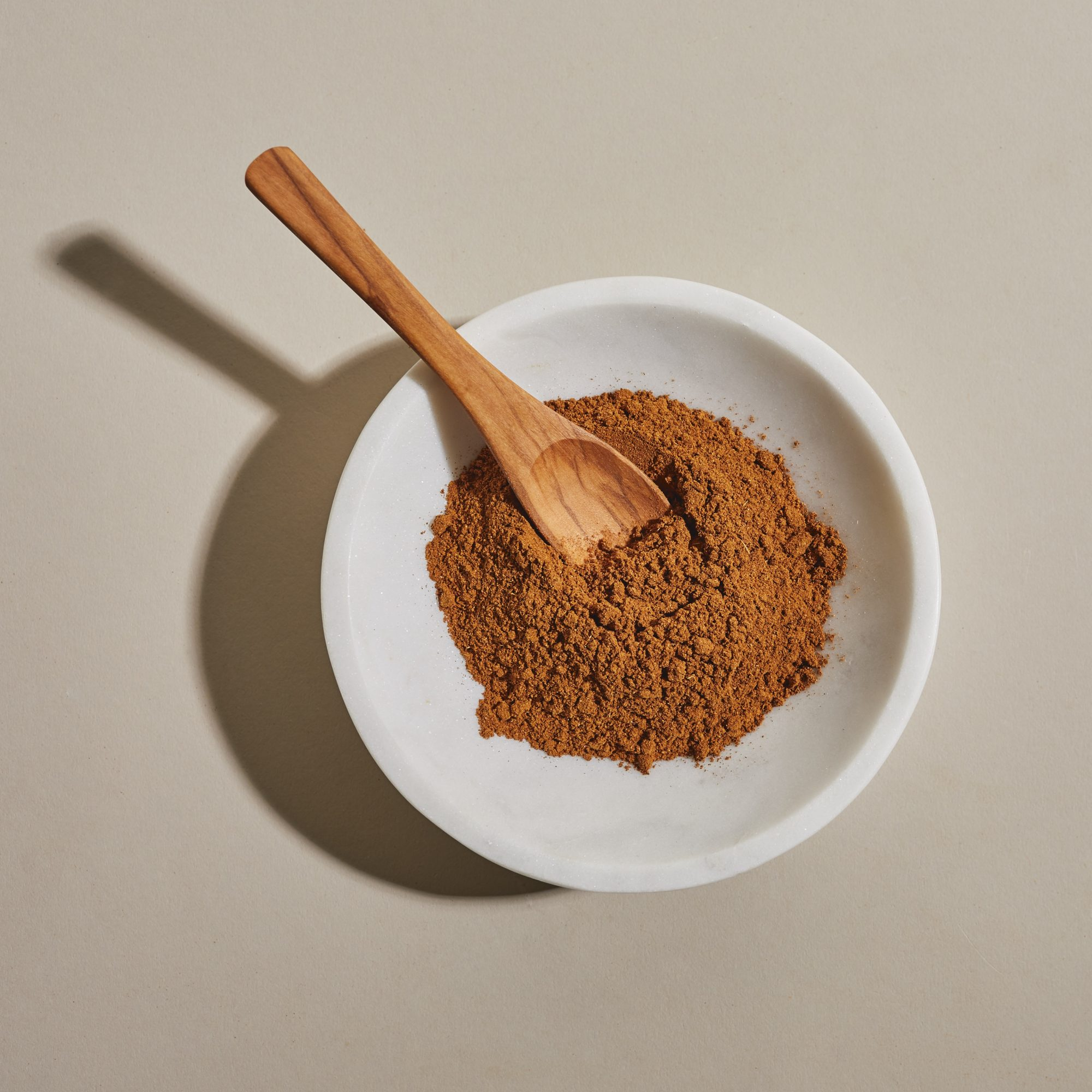 five-spice powder in bowl with spoon