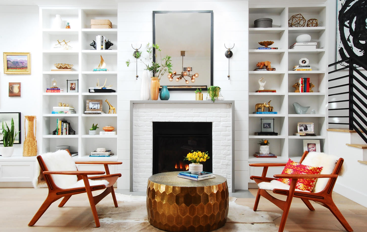 fireplace surround in white with colorful accessories