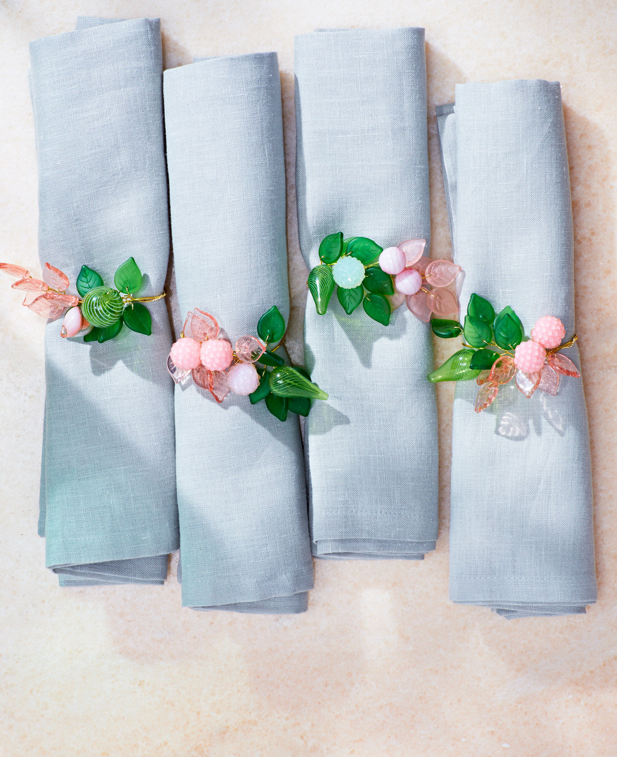 a set of napkins with floral napkin rings
