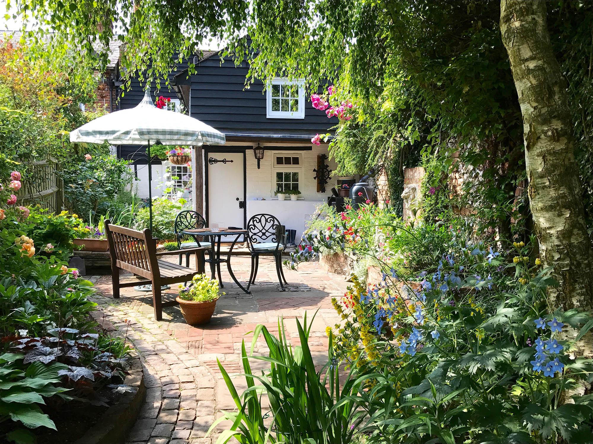 An English cottage garden and patio area