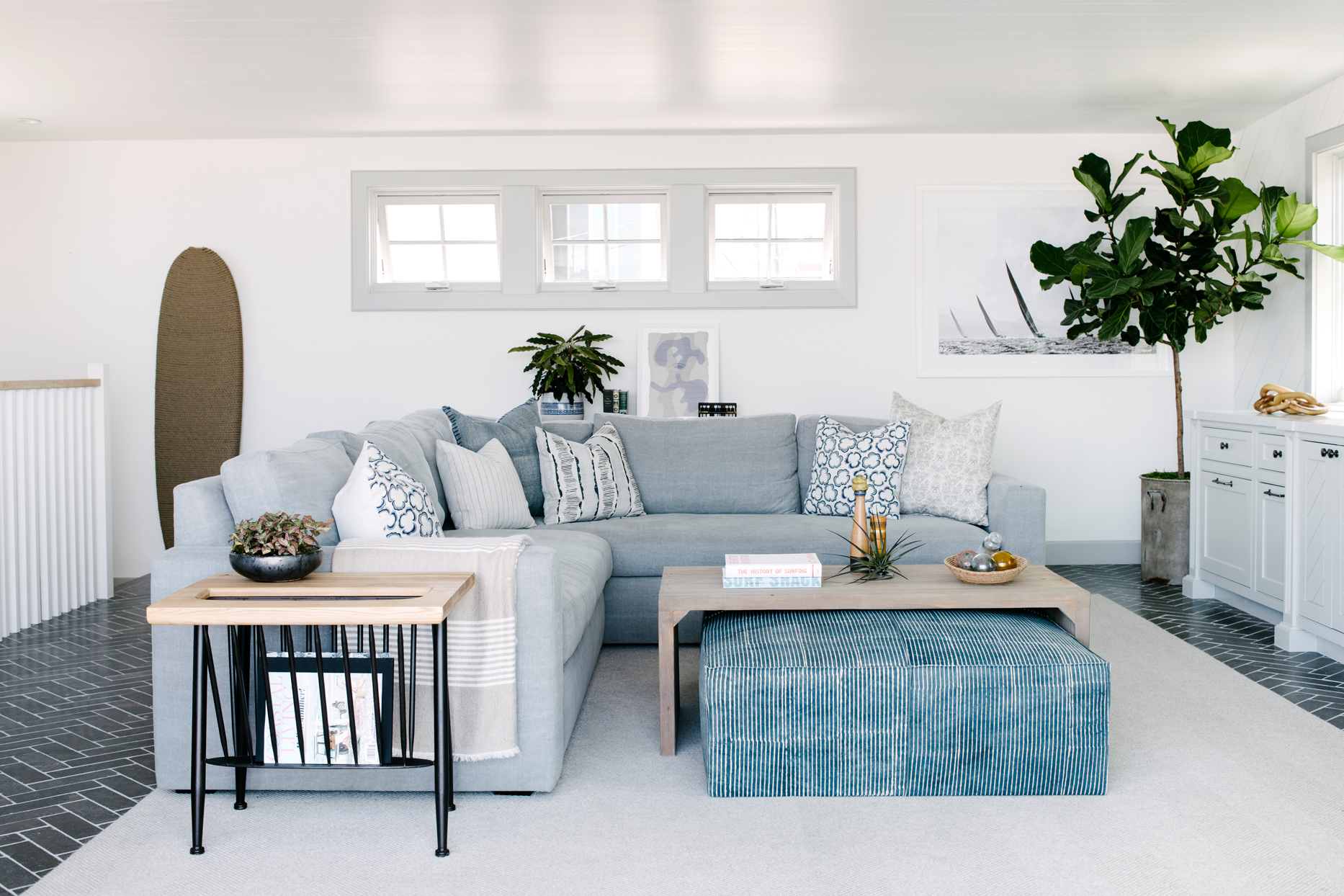 pale blue sectional with large ottoman under coffee table