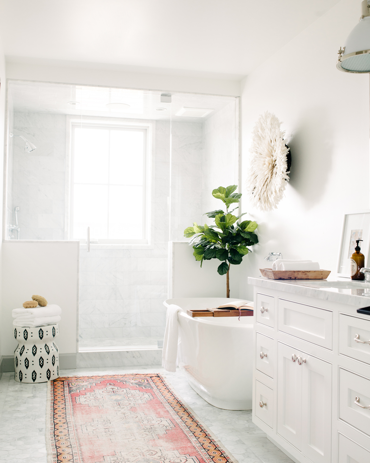 white themed bathroom bathtub standing shower