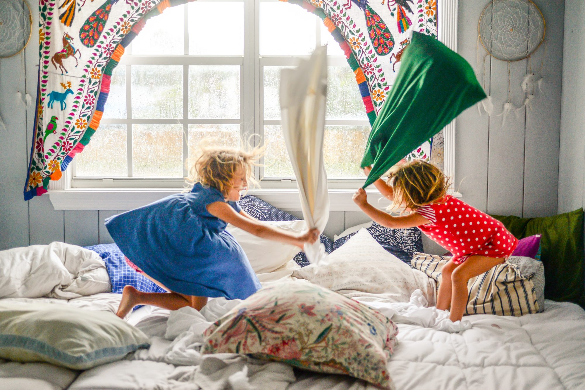 two girls having a pillow fight