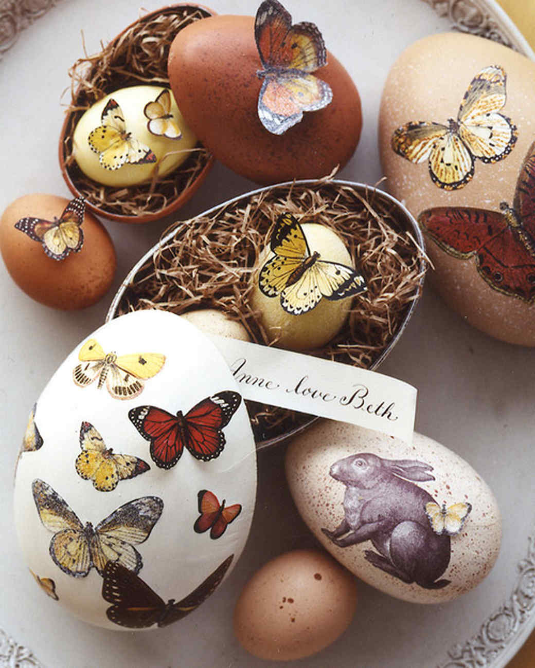 Give egg-shaped boxes a natural touch with speckled paint, butterflies, and a rabbit cut from decorative paper. To begin, cover work surface with scrap paper. Paint exterior of an egg-shaped papier-mache box with acrylic craft paint as desired. Mix equal parts of a contrasting-color paint and water in a bowl. Dip a toothbrush into thinned paint; shake off excess. With bristles facedown over box, draw the handle of a small brush across bristles to spray dots of paint. (Practice on scrap paper first.) Let dry. Cut out butterflies from decorative paper using small scissors. Attach a flat butterfly: Coat back of cut-out with Mod Podge using brush. Apply cutout to box; smooth using tip of brush handle. Let dry.Shop Now: Martha Stewart Confetti Glitter Acrylic Craft Paint, $5, michaels.com. Roylco Decorative Hues Paper, $21.34, target.com. Oval Paper Mache Boxes, $2.79, hobbylobby.com.
