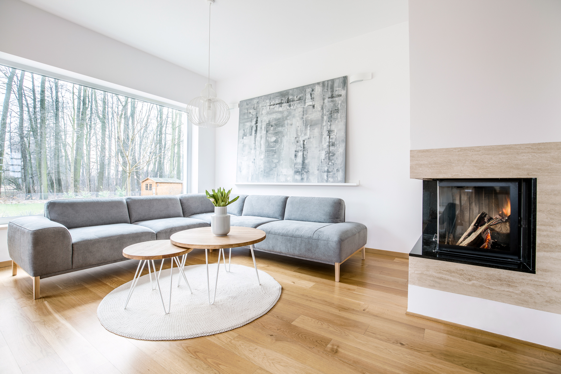 minimalist neutral-colored living room with fireplace