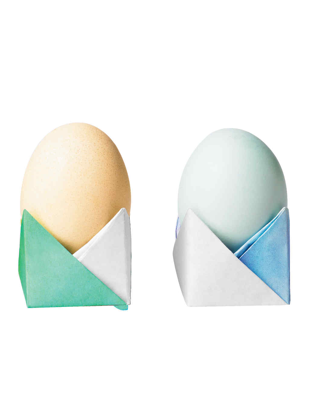 Easter eggs sitting in origami-folded paper cups