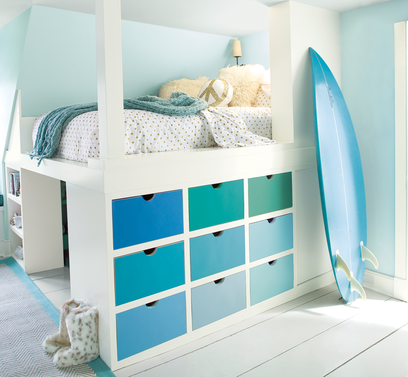 kids bedroom with green and blue drawers and surf board