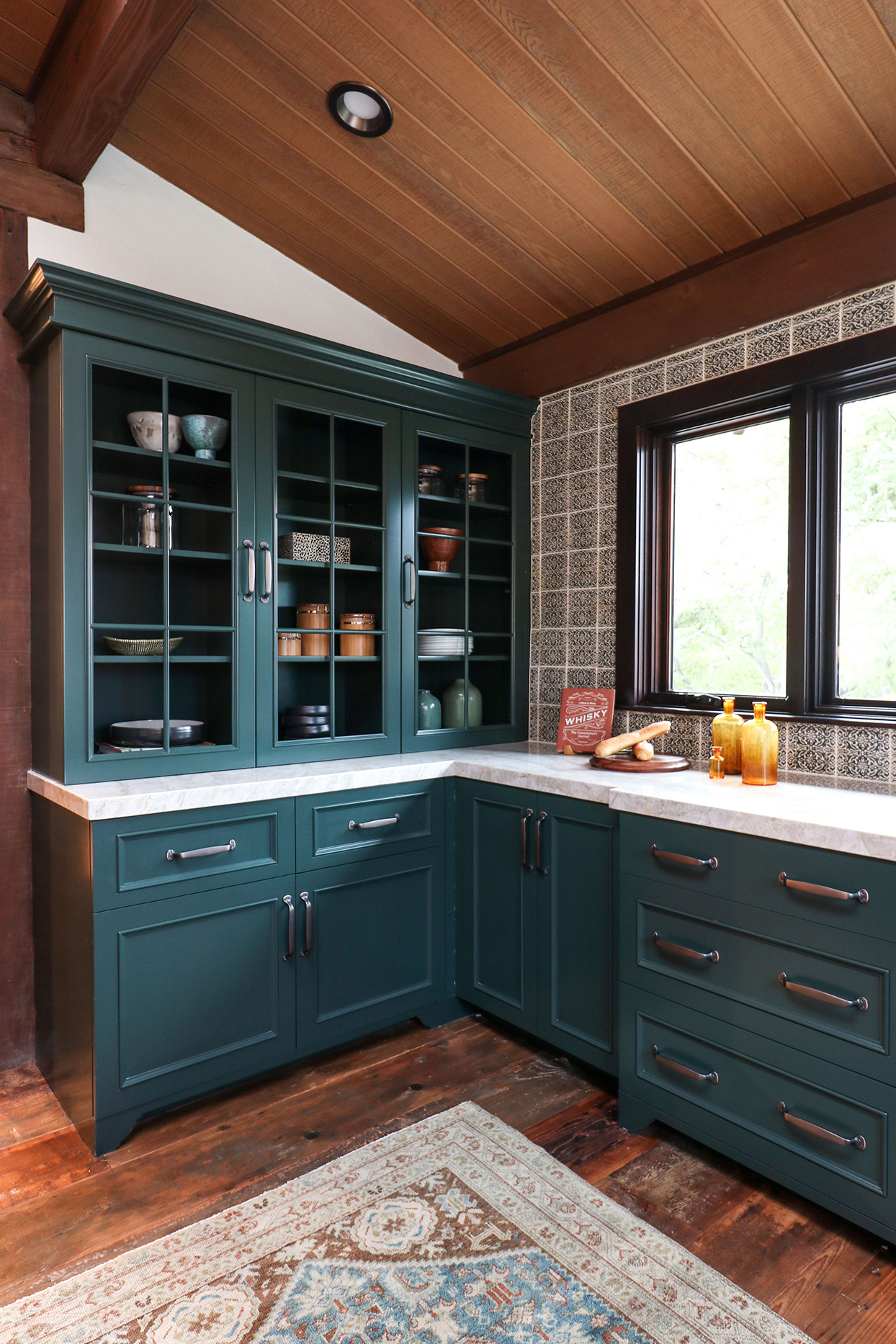 blue-green and earth hues kitchen with tiled backsplash