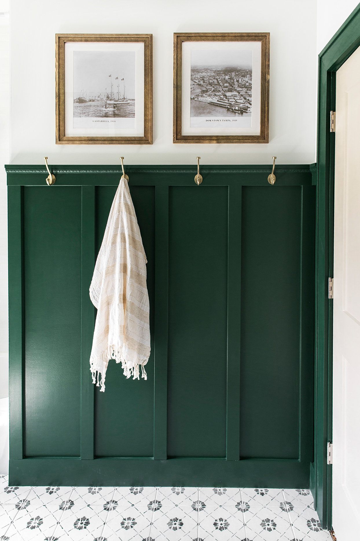 dark green bathroom wall with white flooring and ceiling